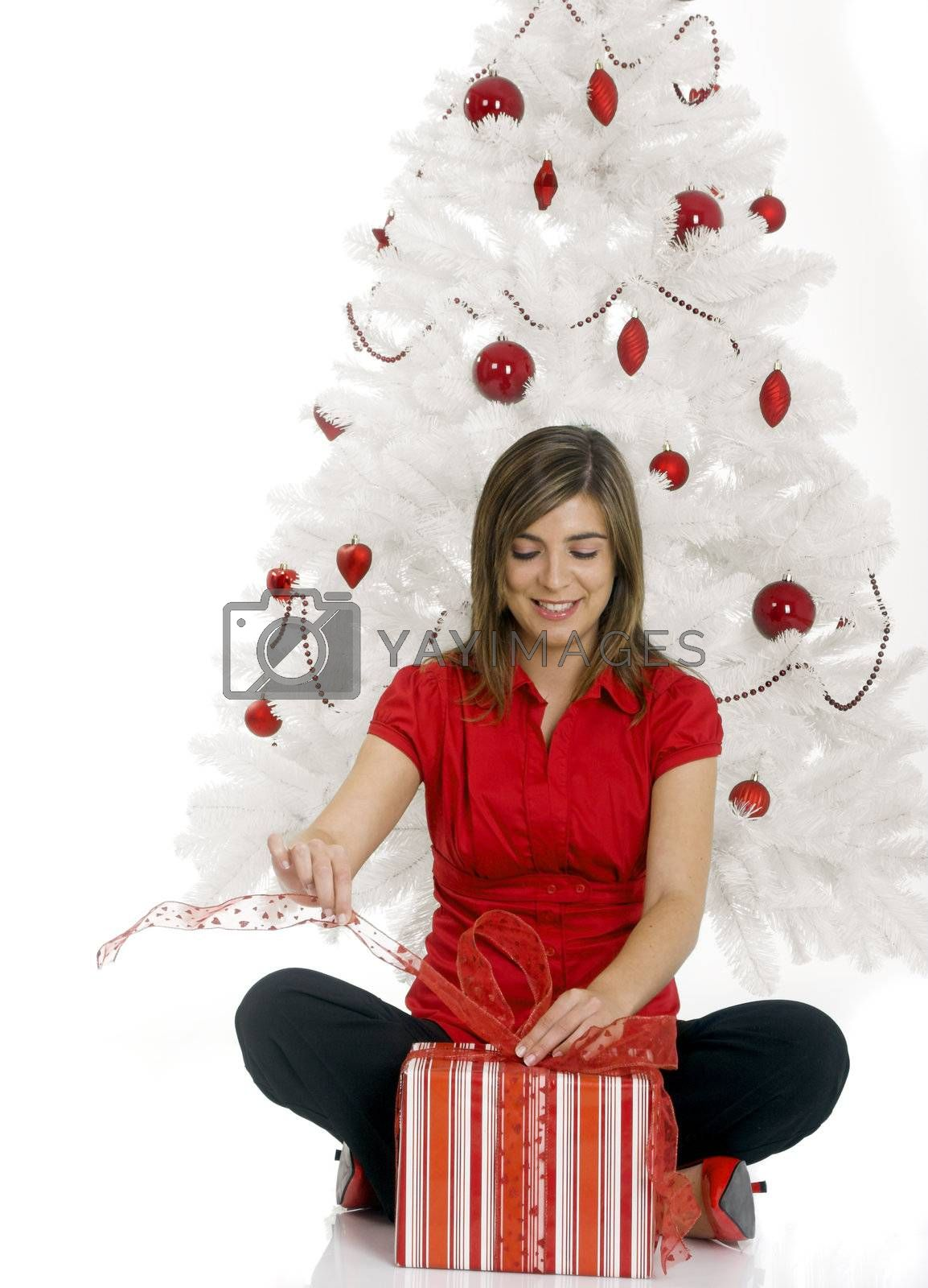 Happy woman with Chirstmas gifts by Ikostudio