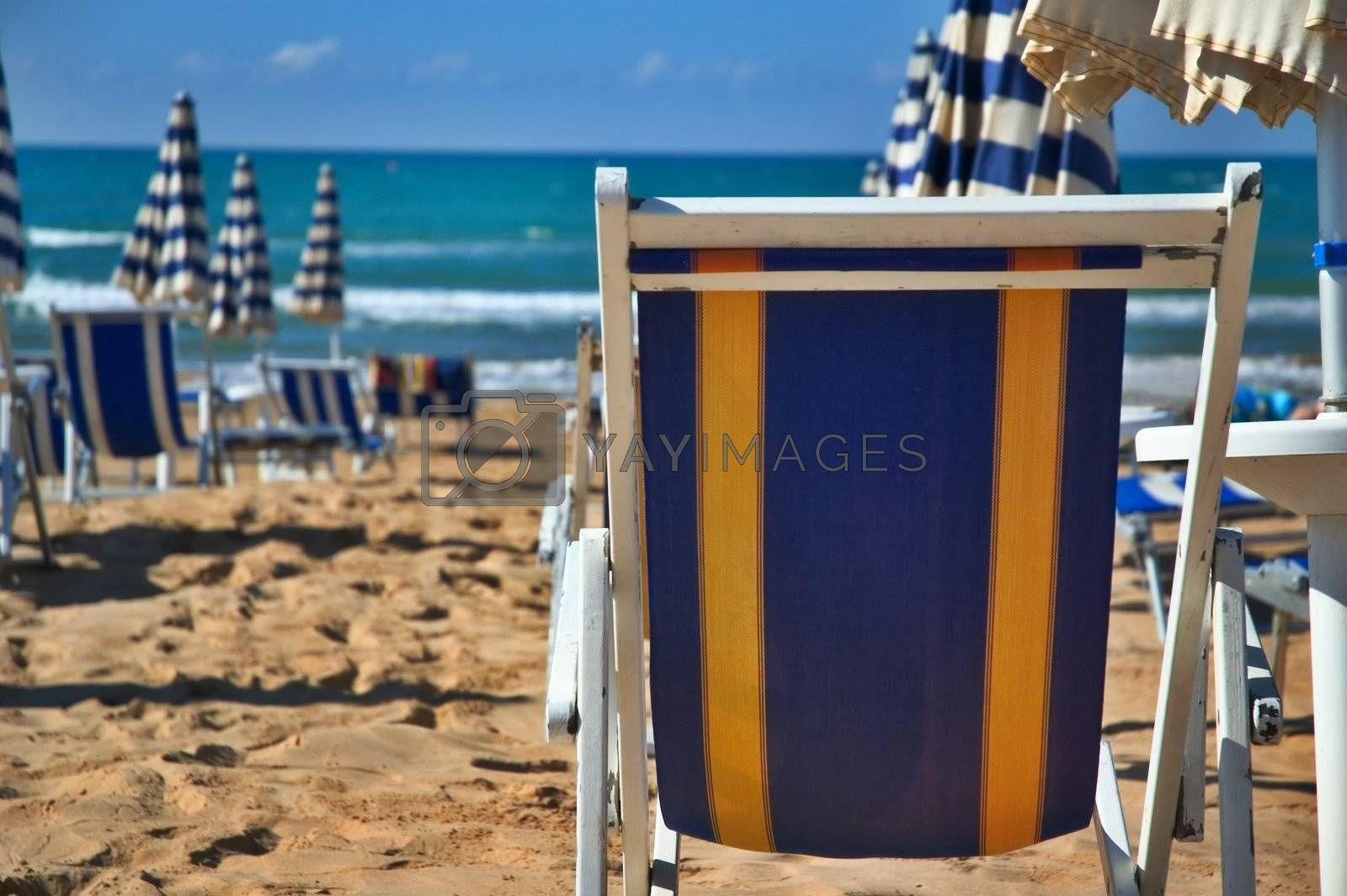 Deck chair on the beach by sil
