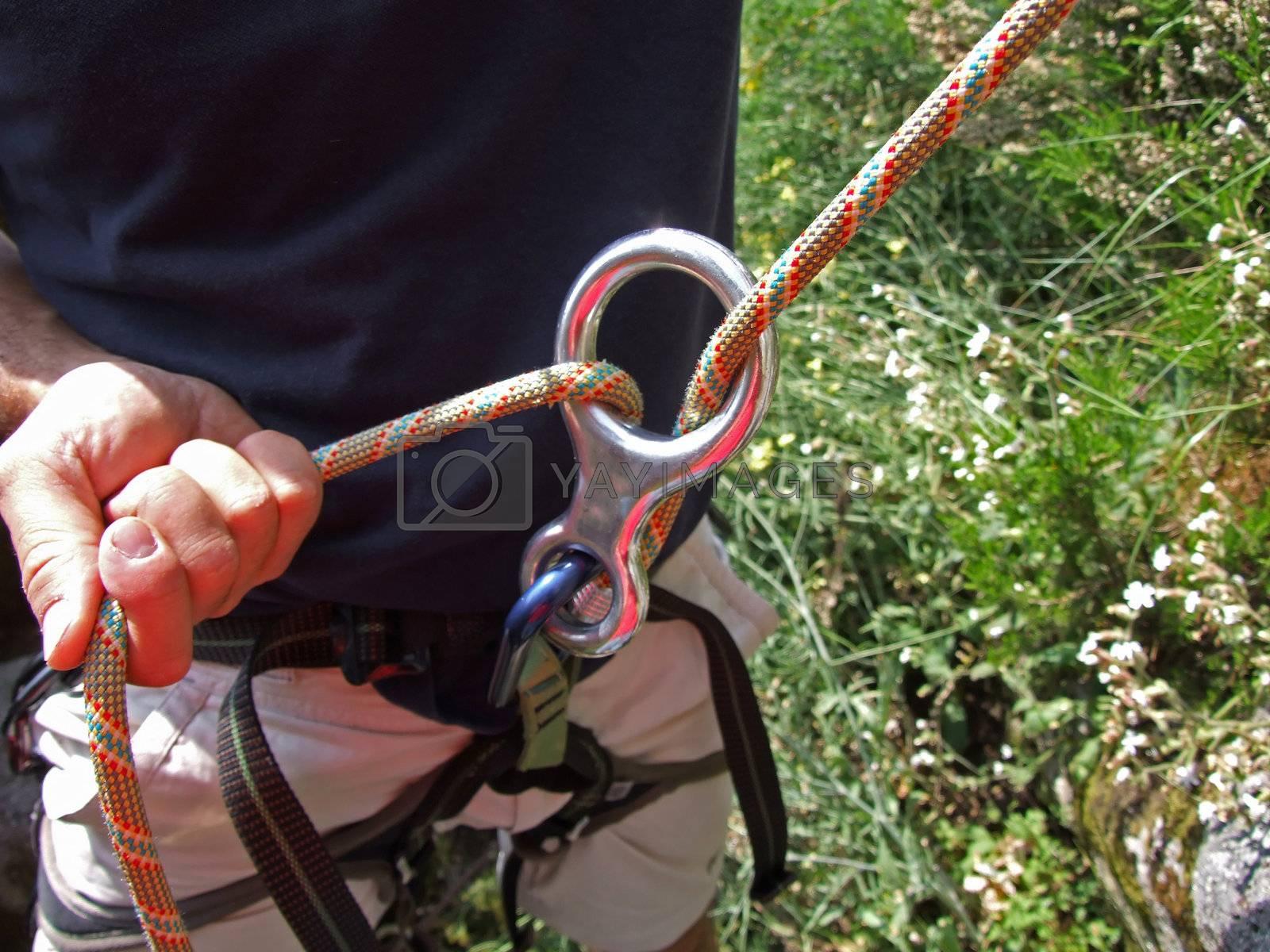 A climber belays another climber  by PauloResende