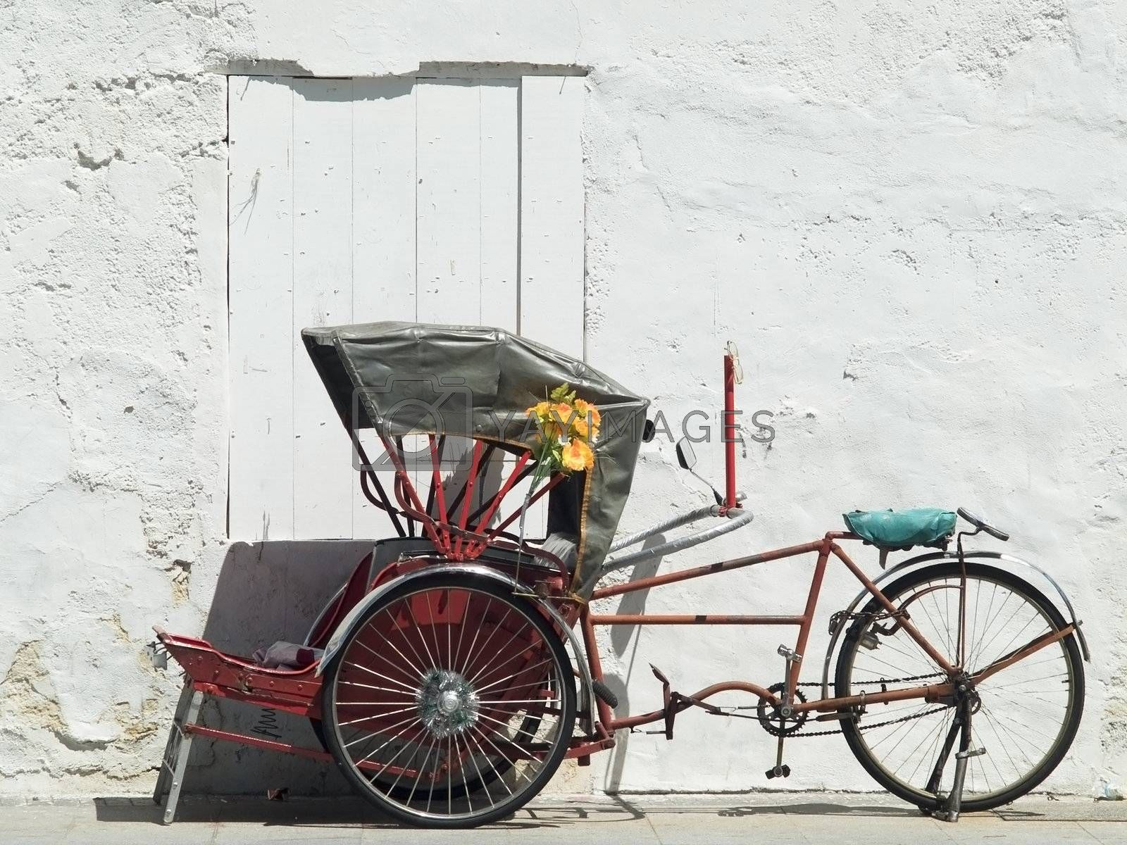 Trishaw parked at a white wall by epixx