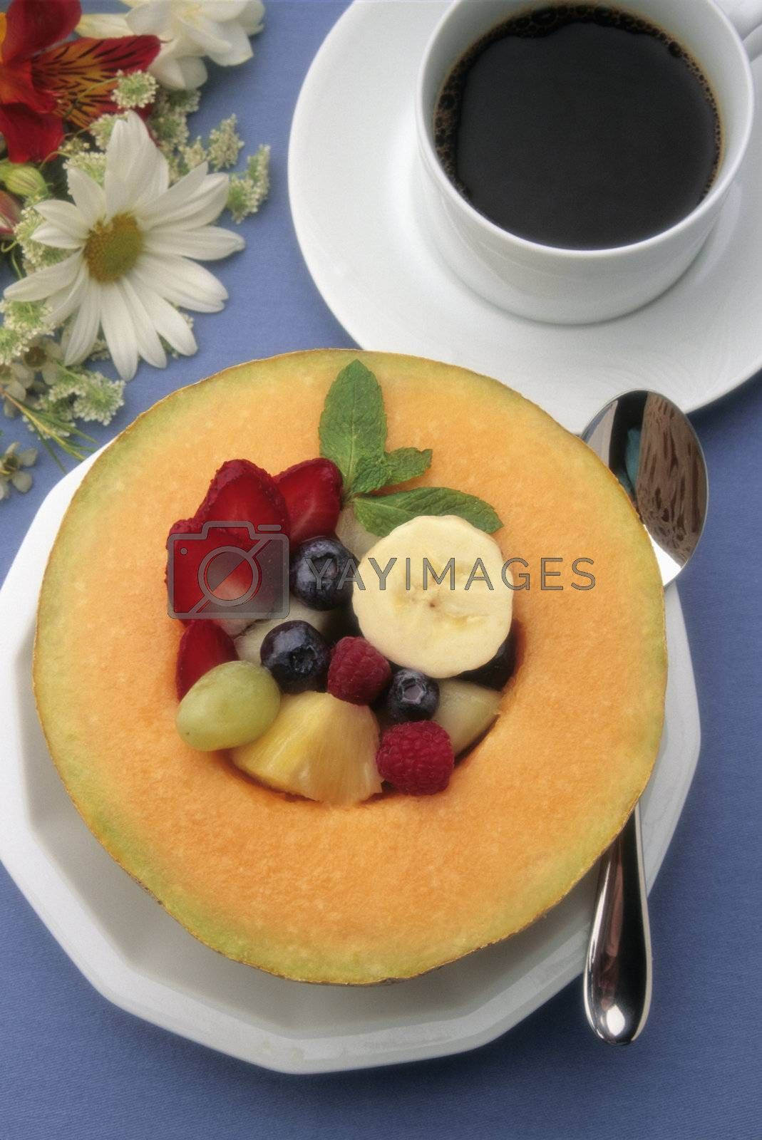 Healthy breakfast  with fresh fruit, coffee and juice on a blue tablecoth