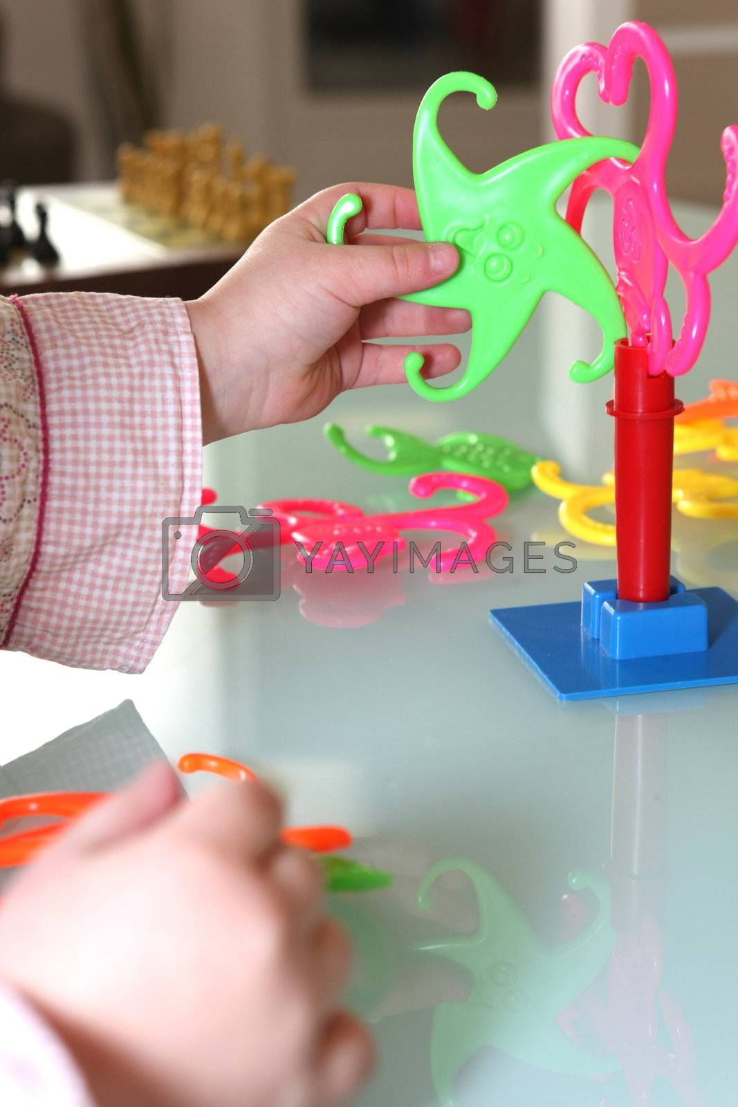 Toddler playing with plastic game