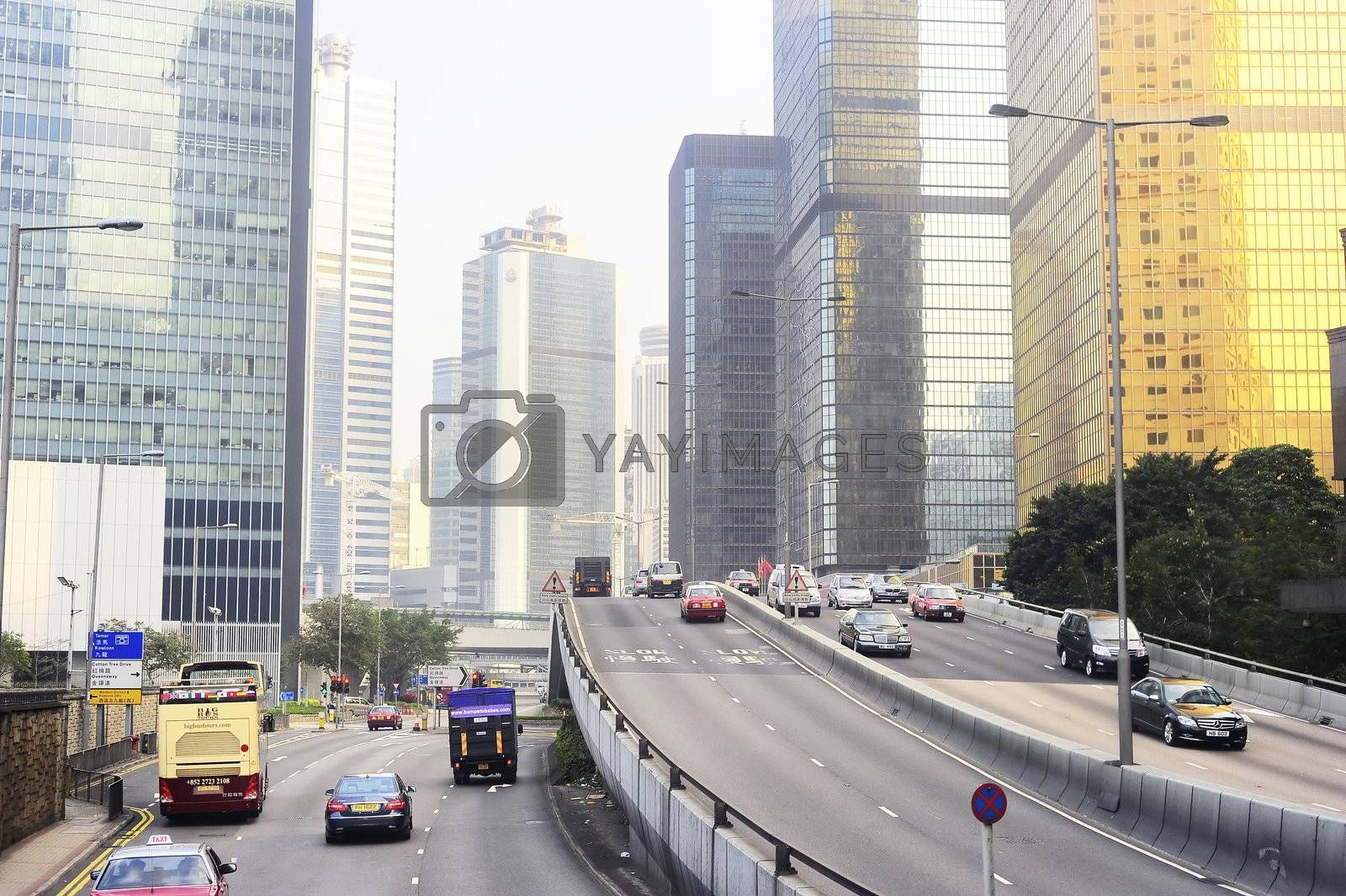 Hong Kong -  January 17, 2013: Many cars on the road at financial center of Hong Kong. Hong Kong is an international financial center, which consists of 112 buildings,standing higher than 180 meters