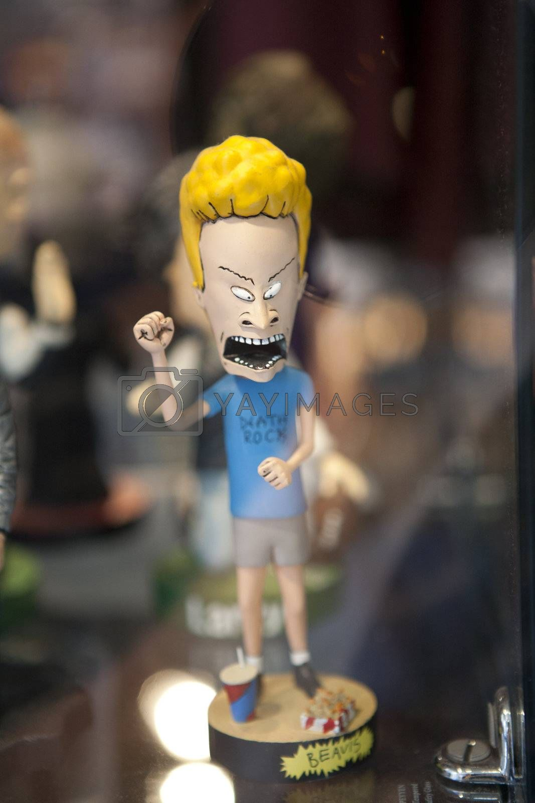 """Beavis from """"Beavis and Butthead"""" bobblehead character, behind glass."""