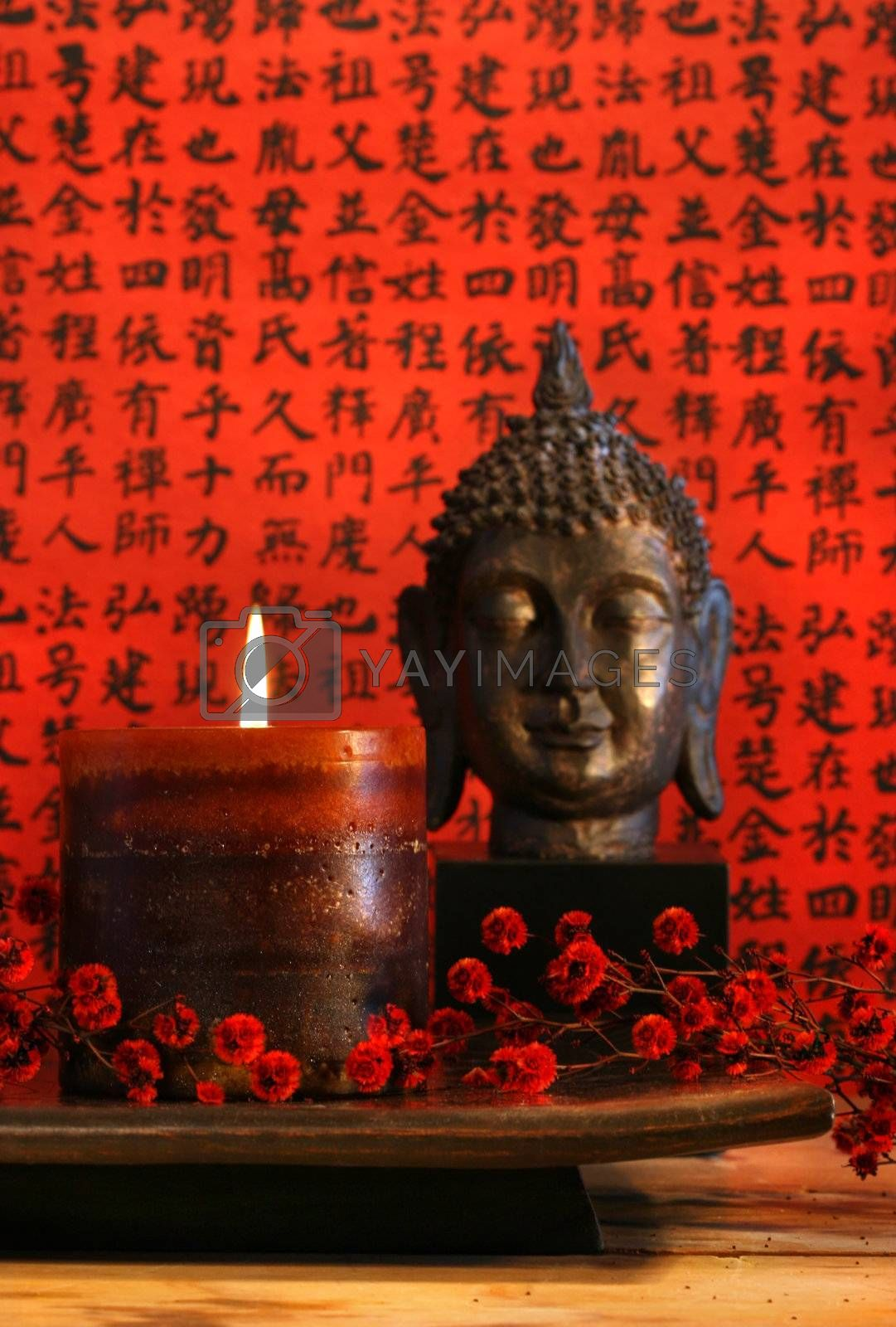 Asian candle with red orential background