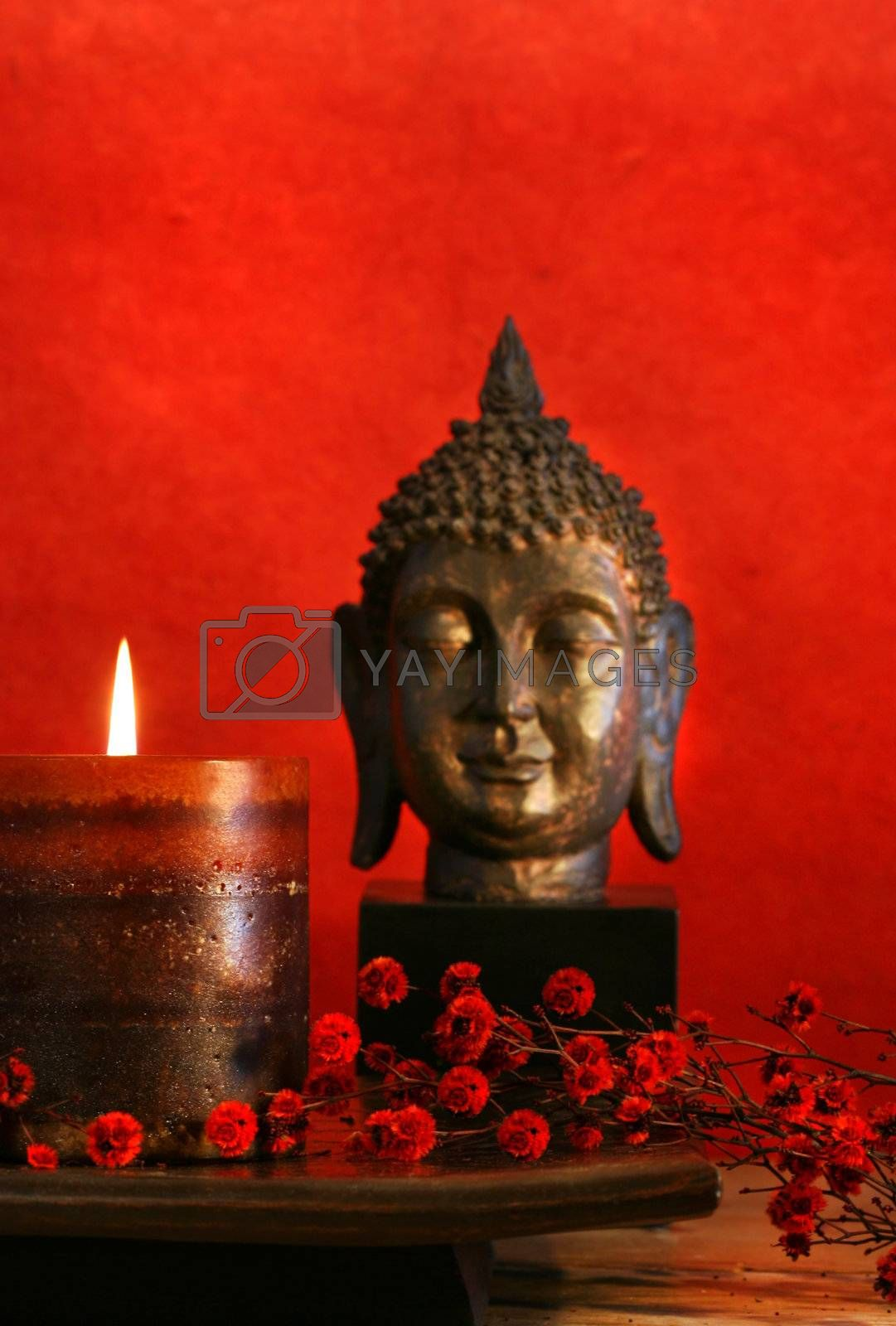 Asian theme with candle and buddha head