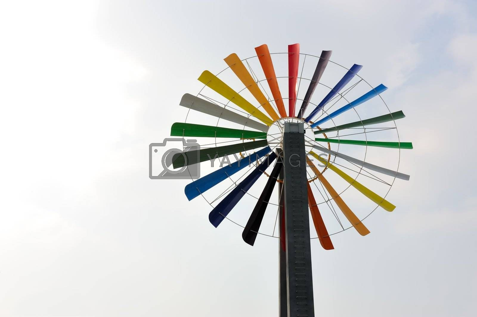 One colorful windmill under the blue sky
