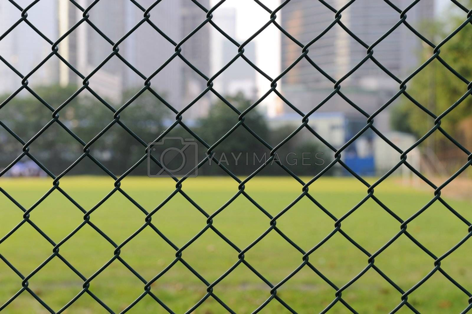 Wire netting with football field as background