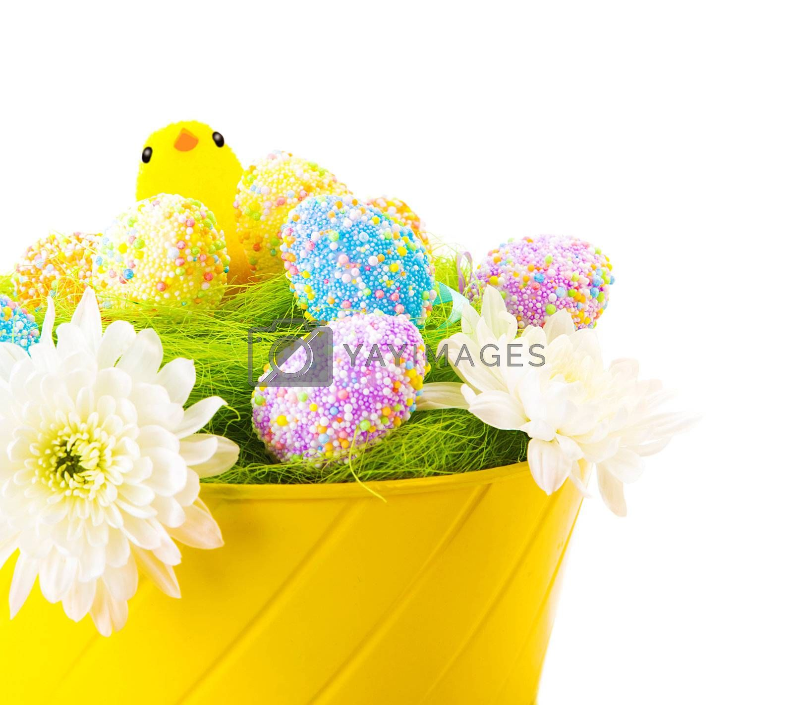 Beautiful Easter still life isolated on white background, colorful eggs decorated with flowers in yellow basket, cute chick
