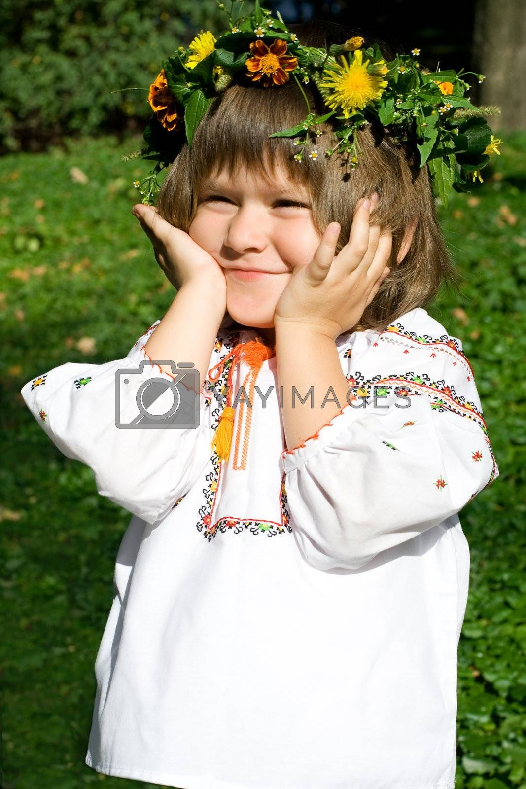 Pretty little girl dressed in Ukrainian folk costume