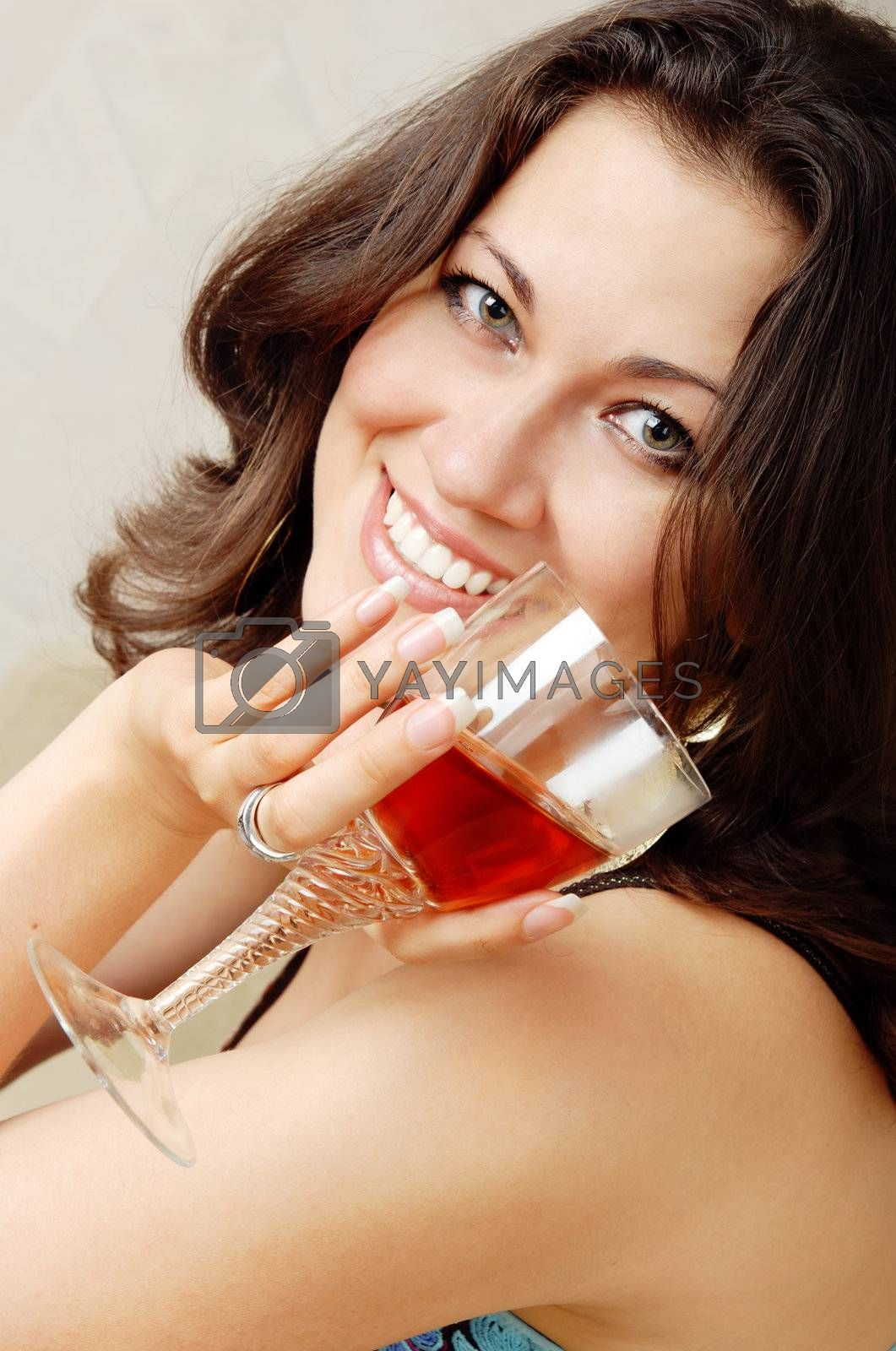 Close-up photo of the smiling lady with alcohole beverage