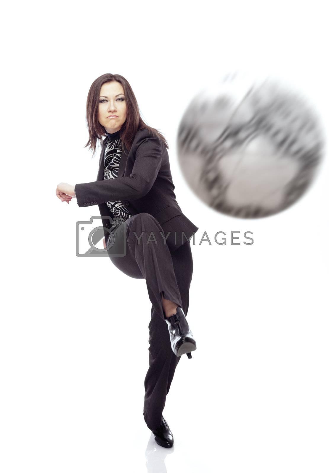 Businesswoman playing football