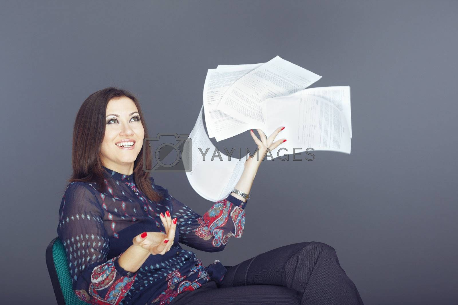 Businesswoman in vacation throwing her documents