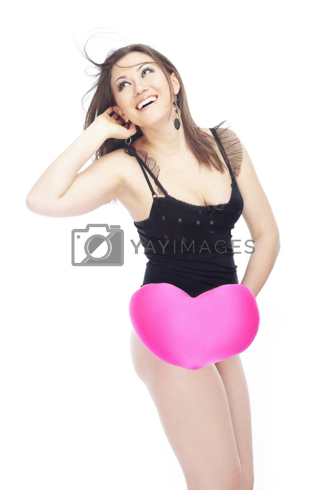 Happy sexy lady with Valentine heart on a white background