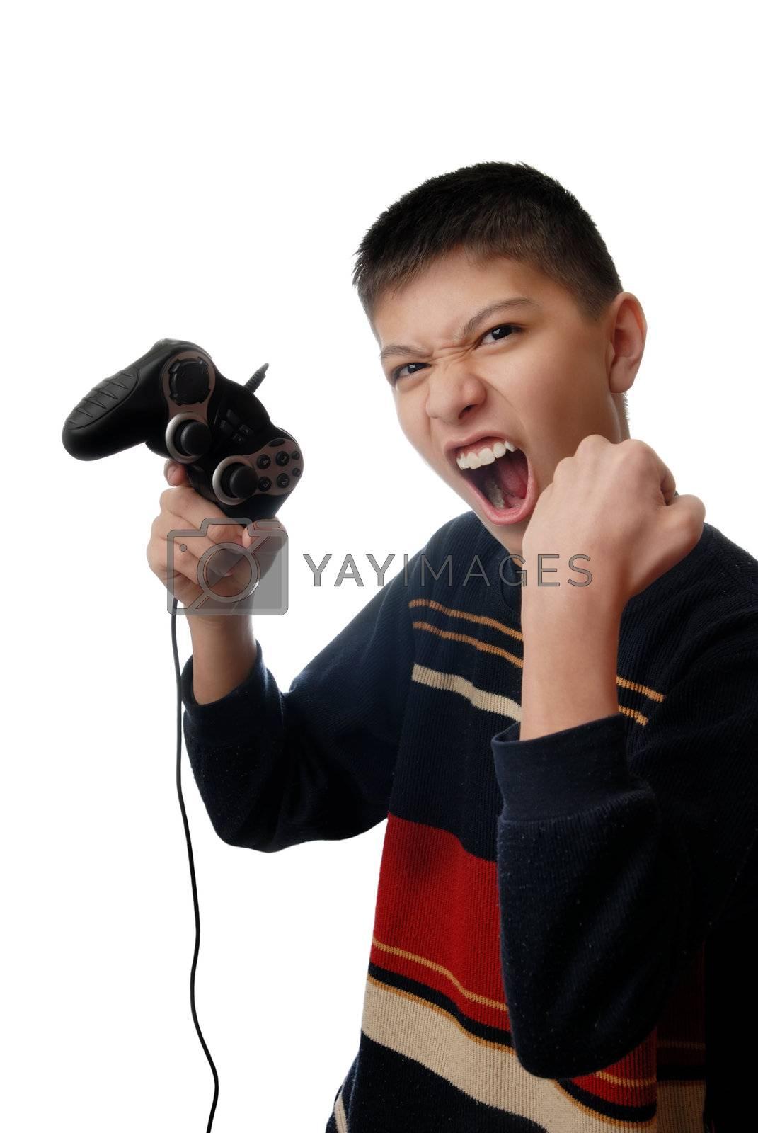 Studio photo of boy winning in computer game