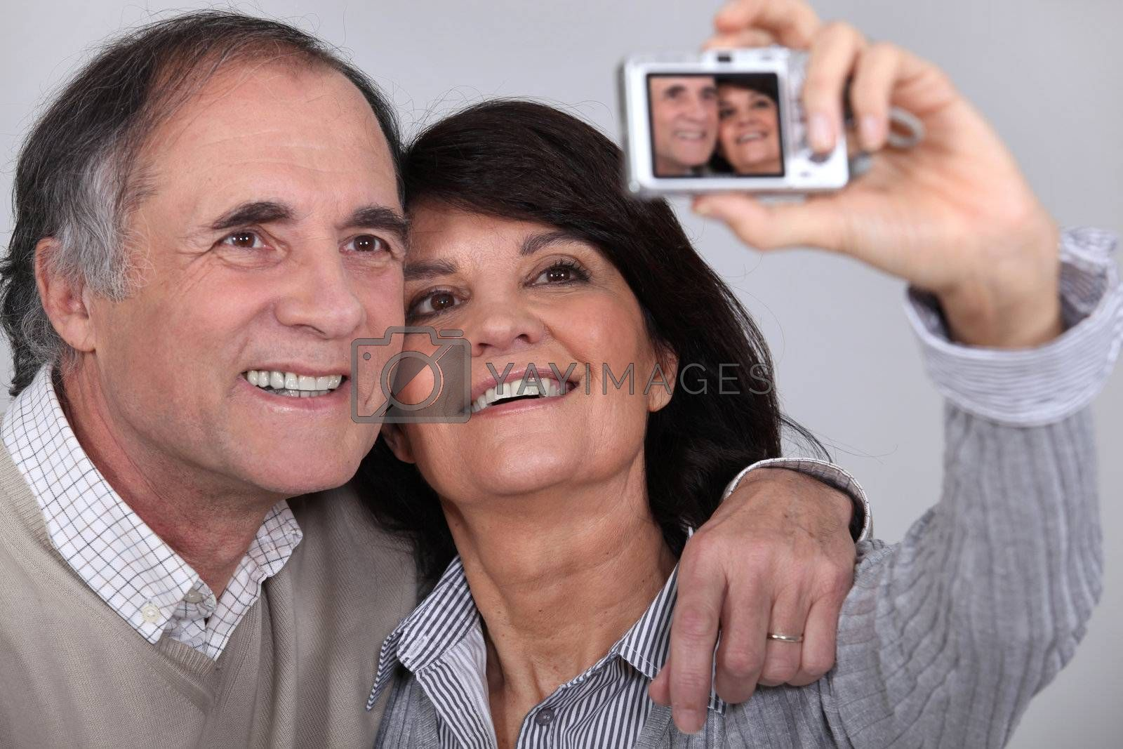 Middle aged couple taking a picture of themselves