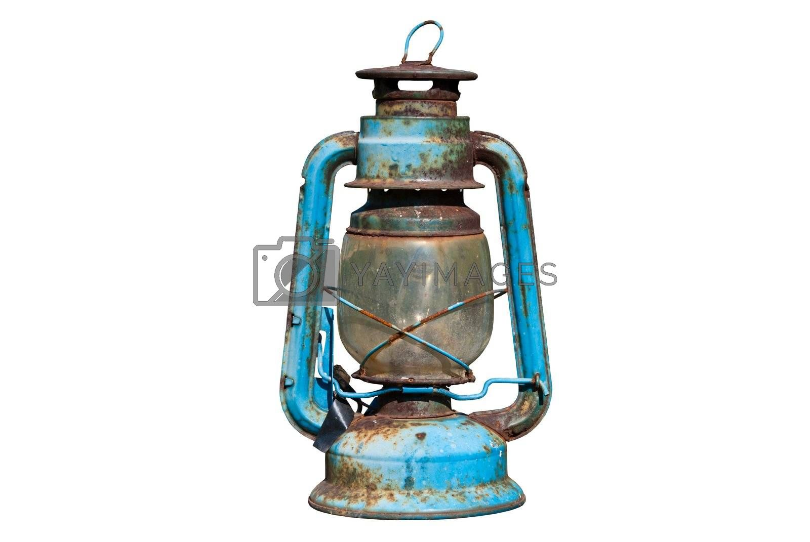 Old rusty oil lamp in isolated white background
