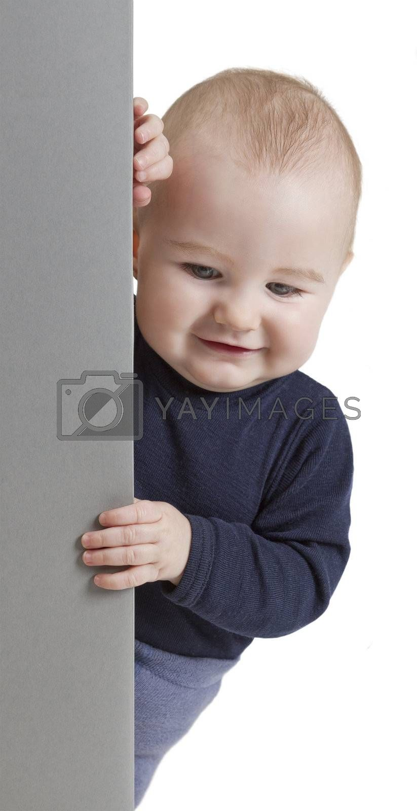 young child holding vertical, grey sign. isolate on white background