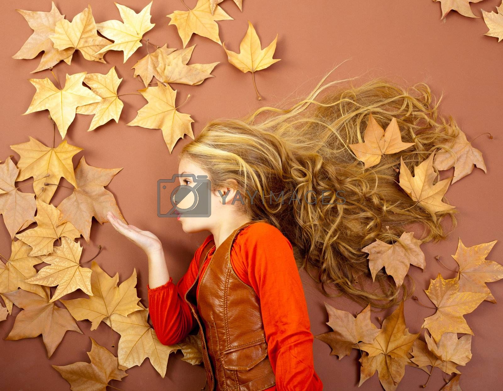 Autumn Girl On Dried Leaves Blowing Wind Lips Royalty Free Stock Image Yayimages Royalty Free Stock Photos And Vectors