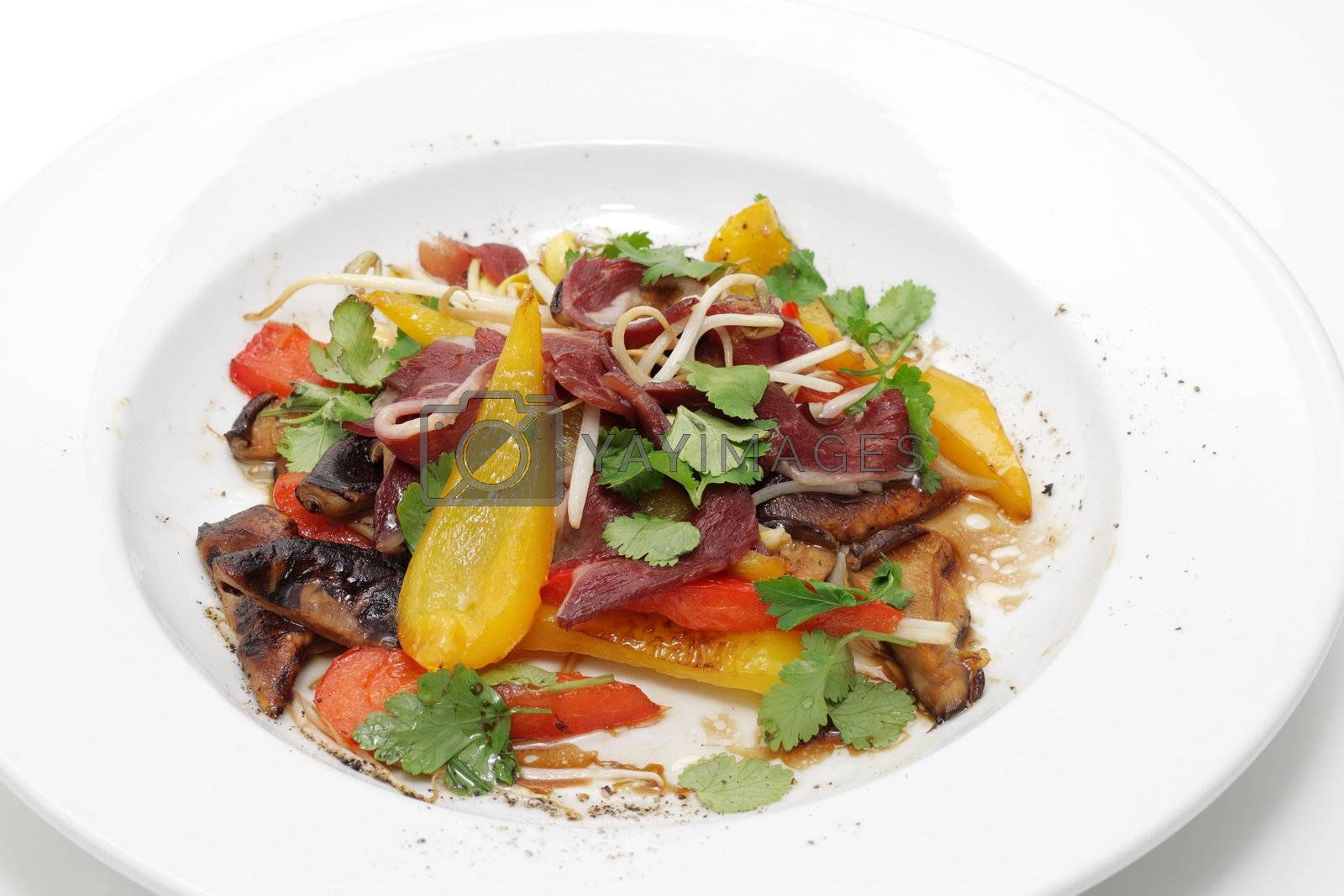 Fillet of a duck breast with a vegetables.