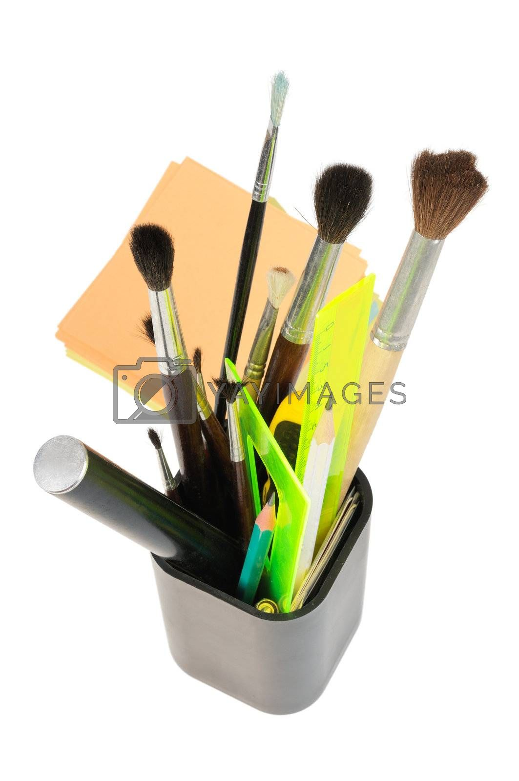 A box with stationery, pens, brushes, rulers. Isolated on white.