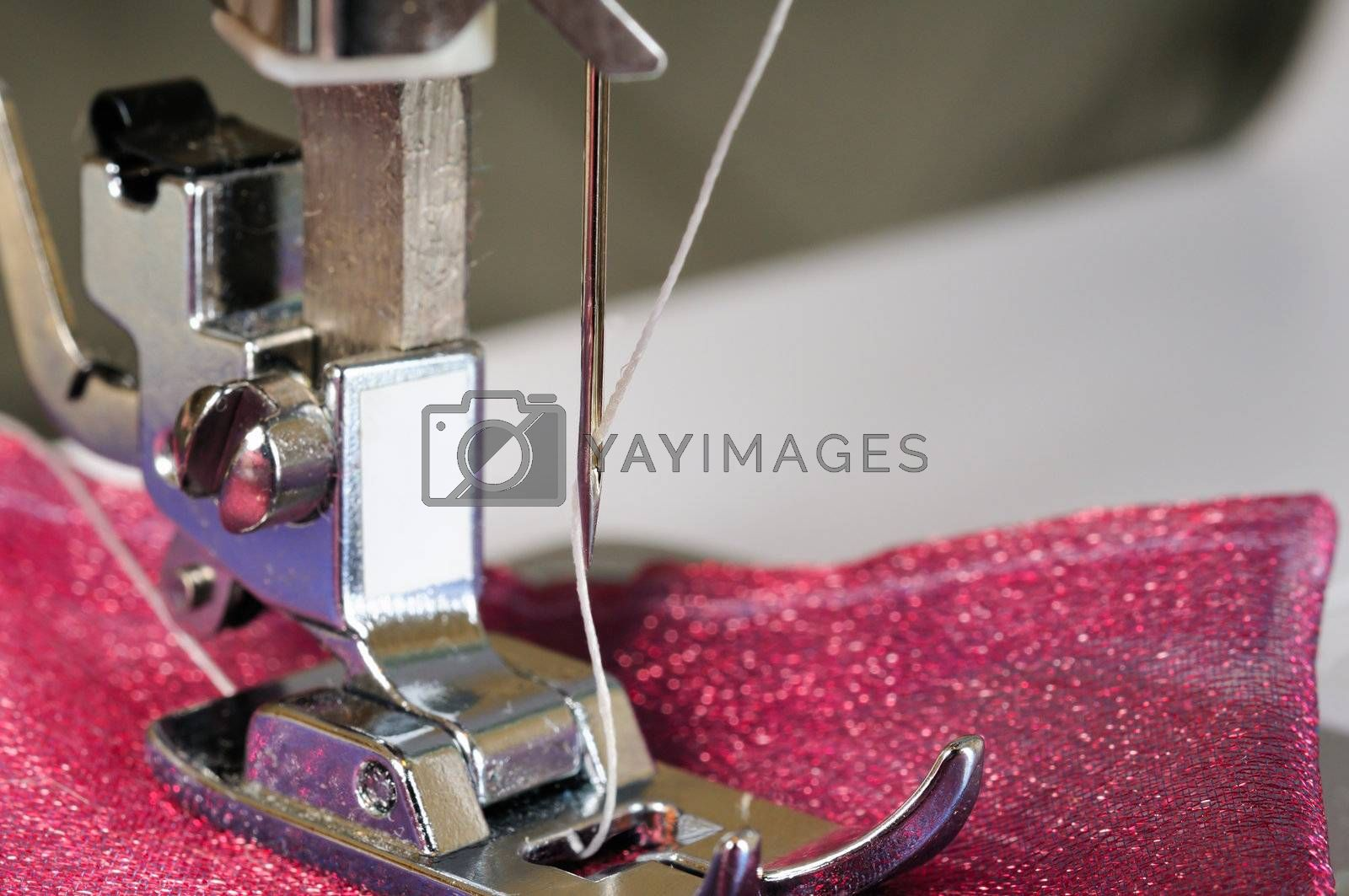 Sewing machine close up with a cloth.
