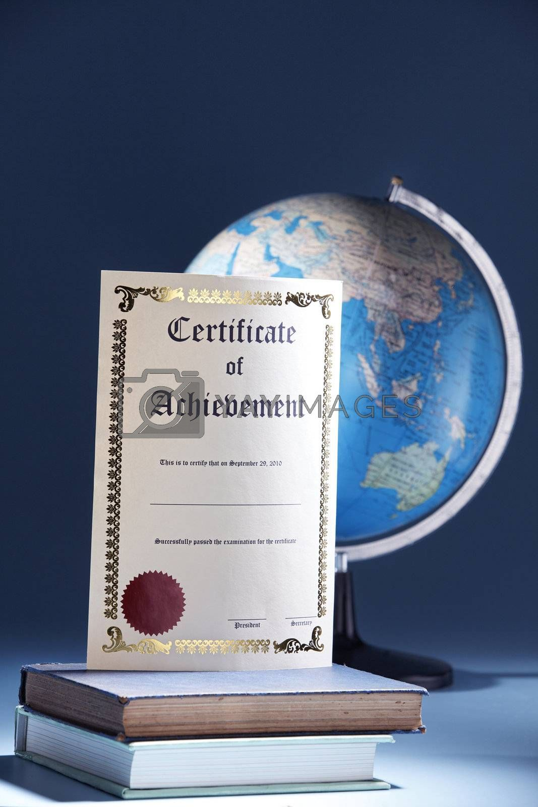 education concept with certificate and globe