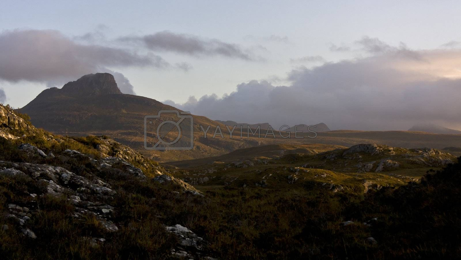 big scottish mountain with wetland in evening light