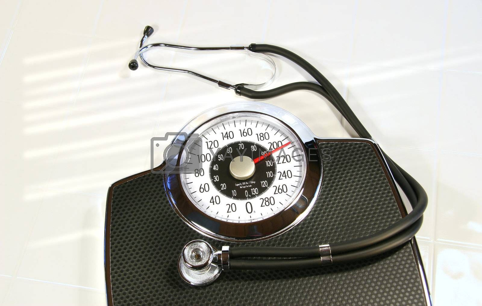 Weight scale with sthetescope on white tile