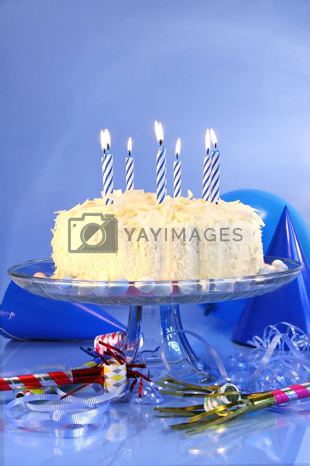 Birthday cake  with blue candles and assorted ribbons