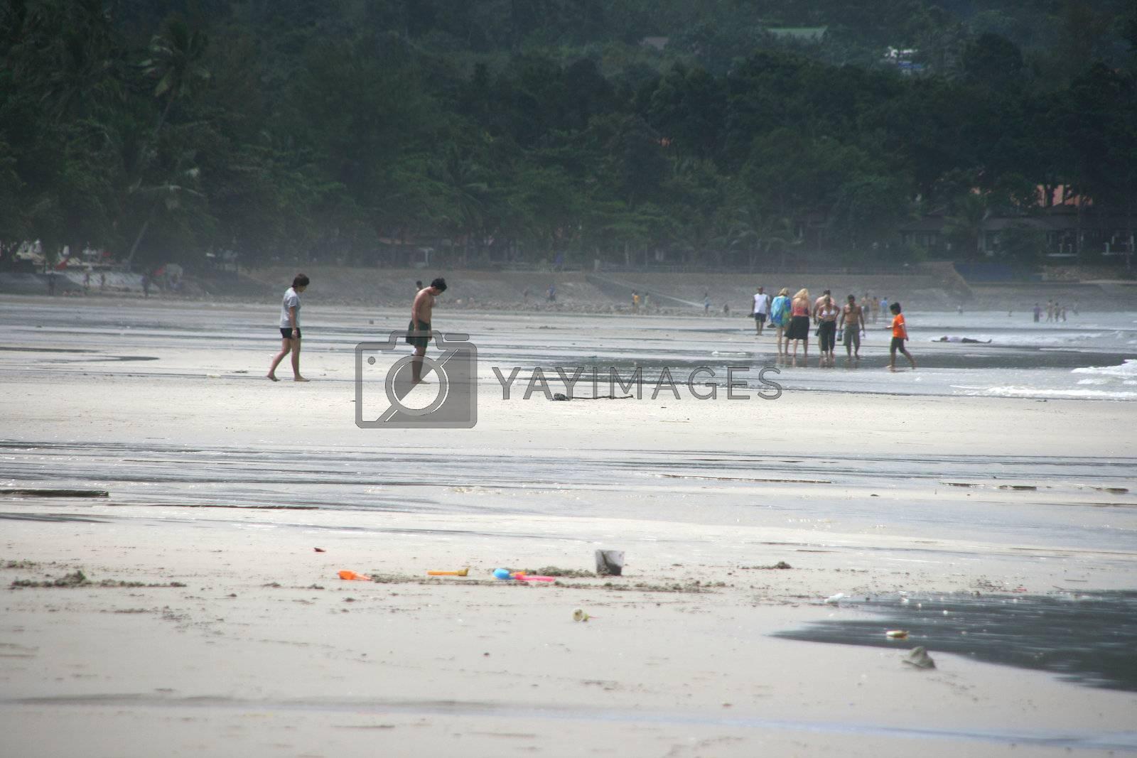 tourists walking on the beach on white sand beach koh chang island thailand