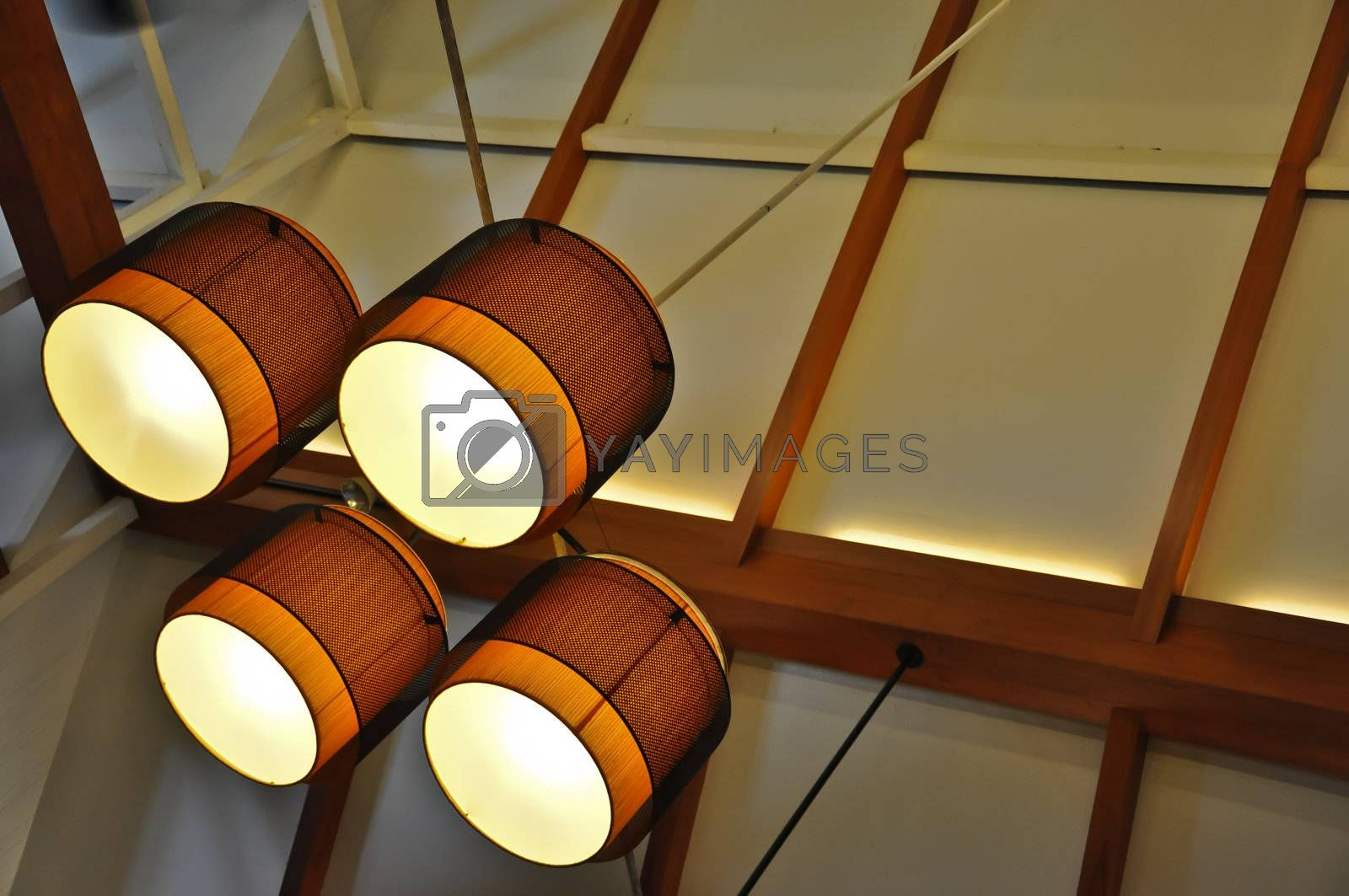 The modern chandelier on ceiling