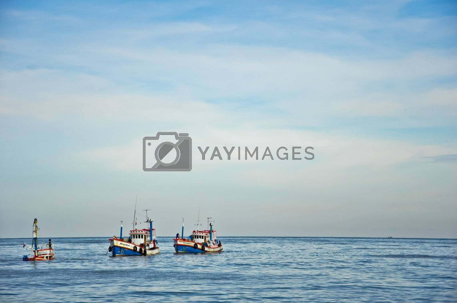 One of three boat is sinking to the sea