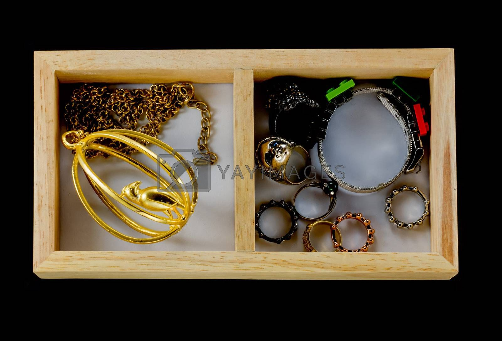 Many accessory such as necklace, rings and bracelet in the wooden box