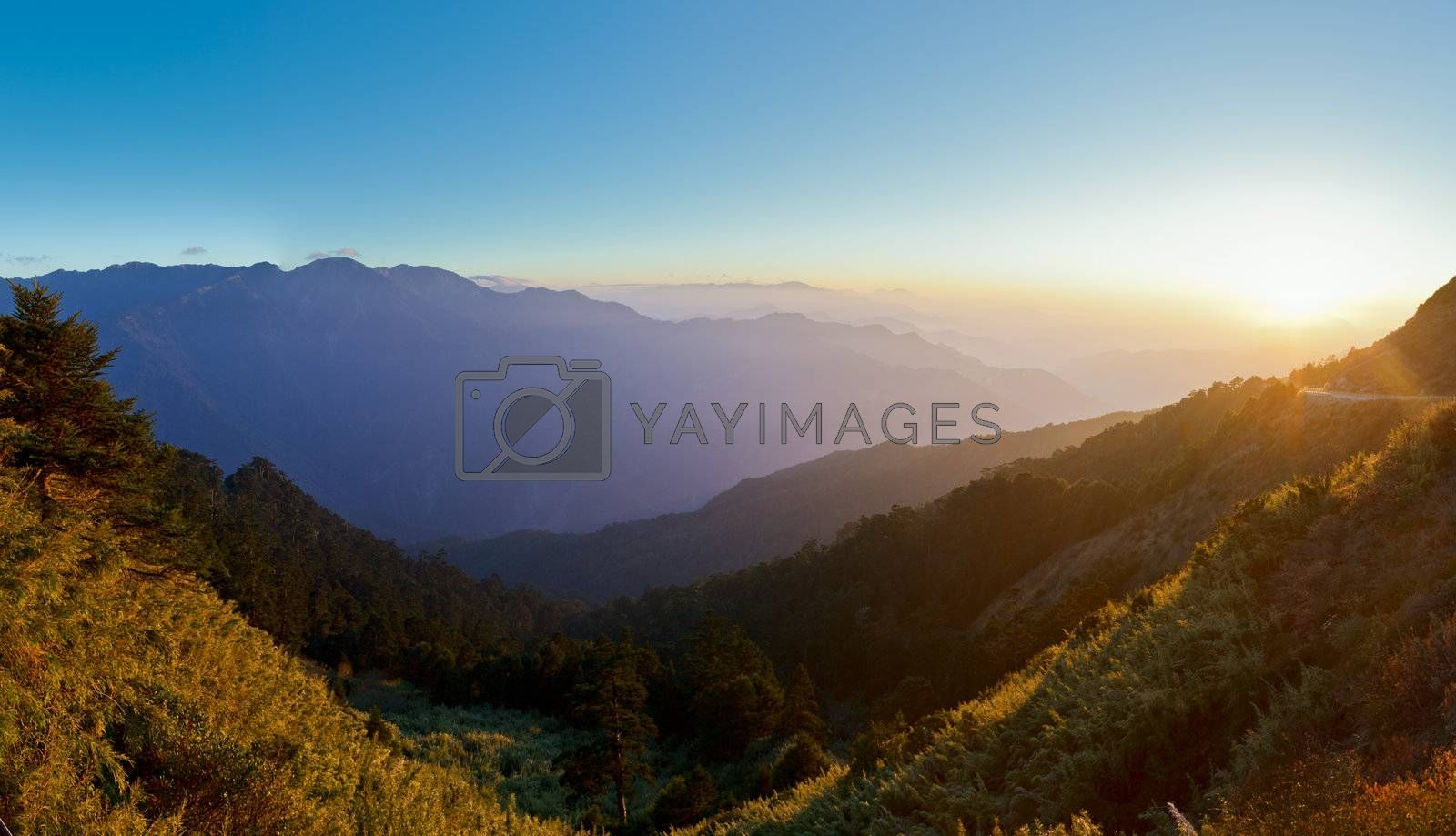 Mountain scenery with sunset flare