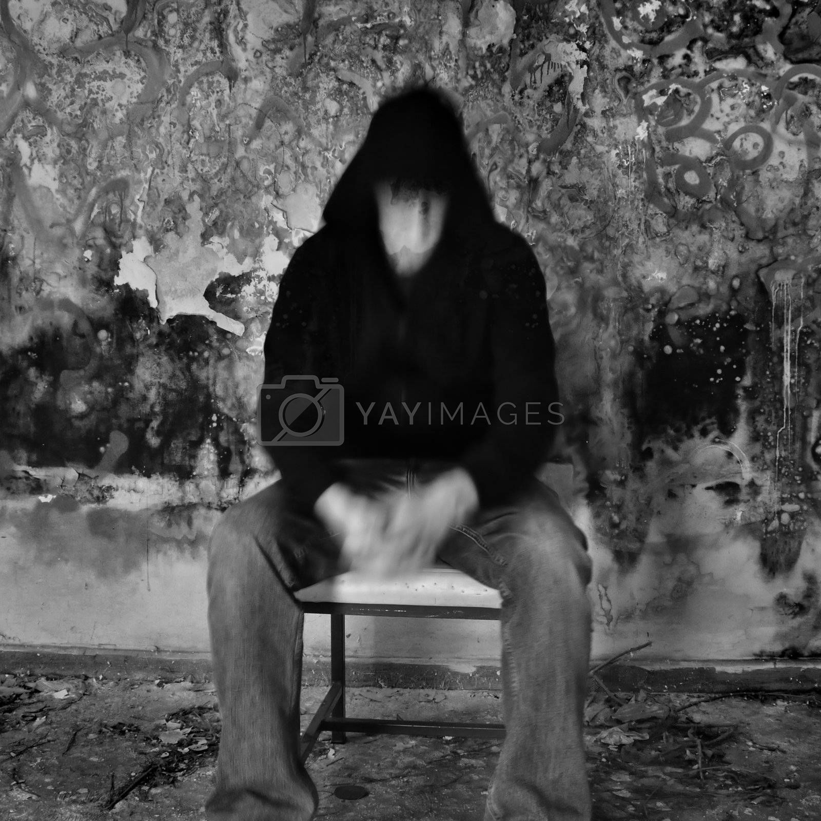 Man dissolving into textured black mold and peeling paint wall.