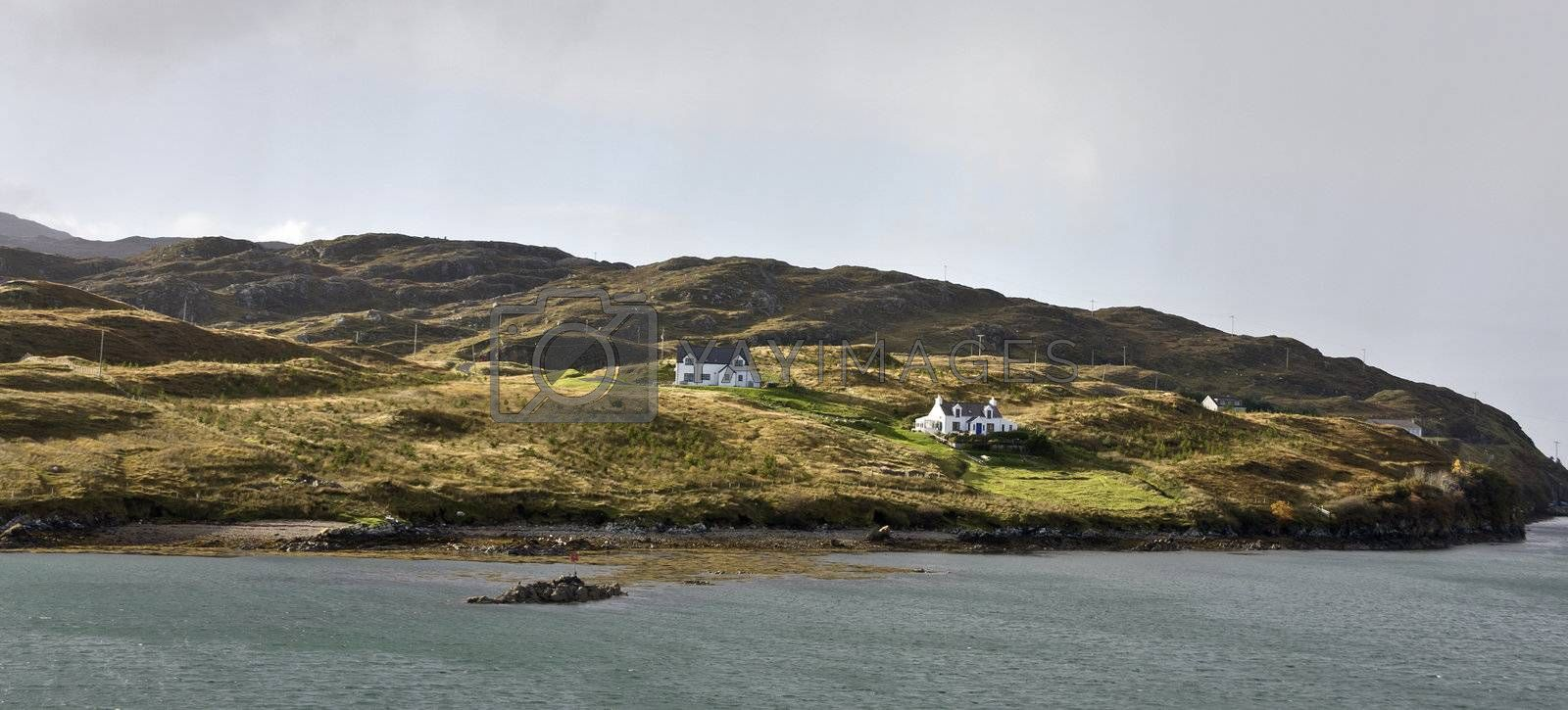 two remote houses at coastline in scotland.