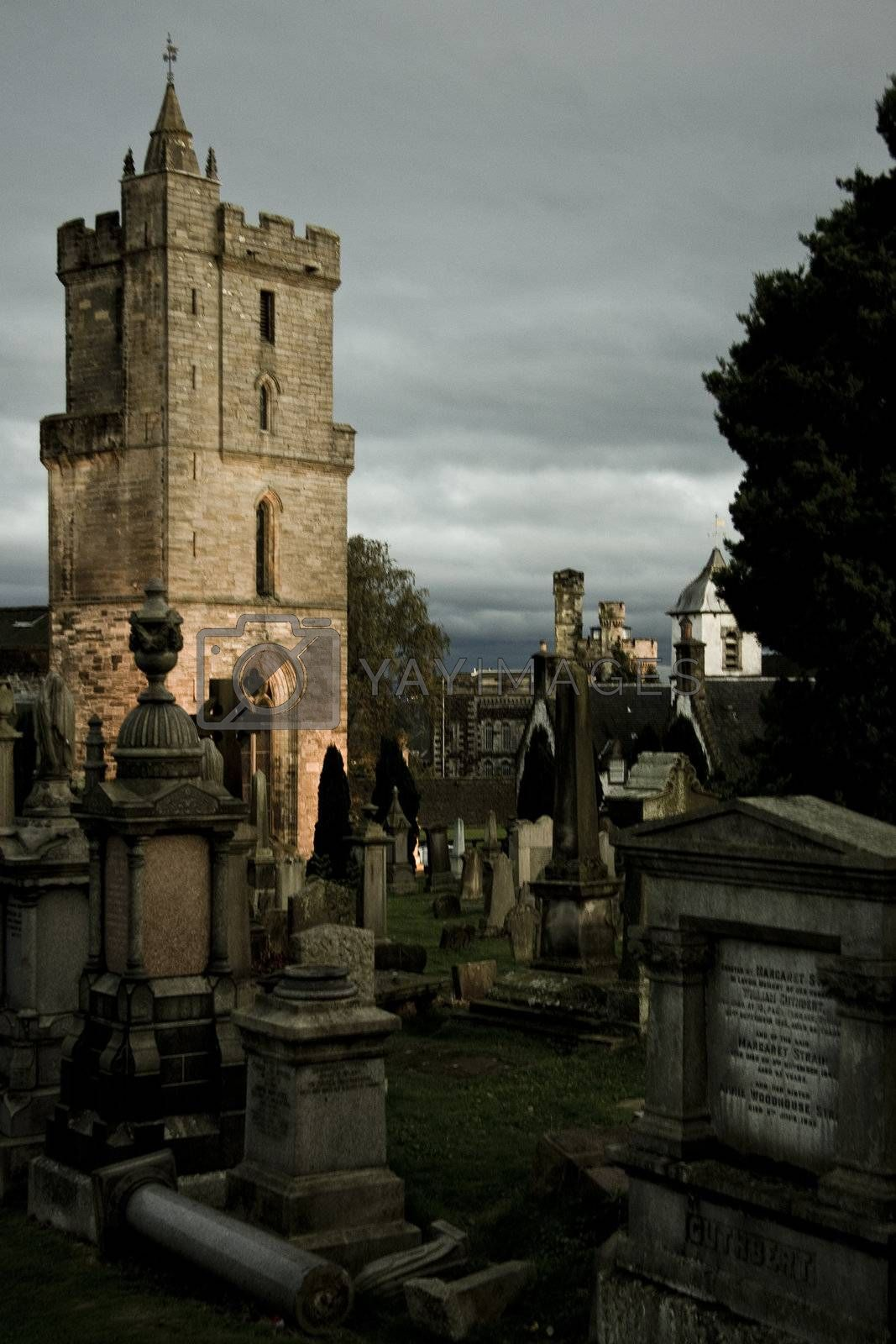 mystic cemetery in stirling with illuminated tower in background