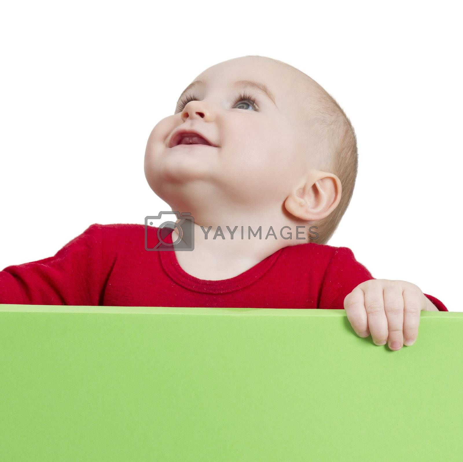 young child holding shield. isolate on white background