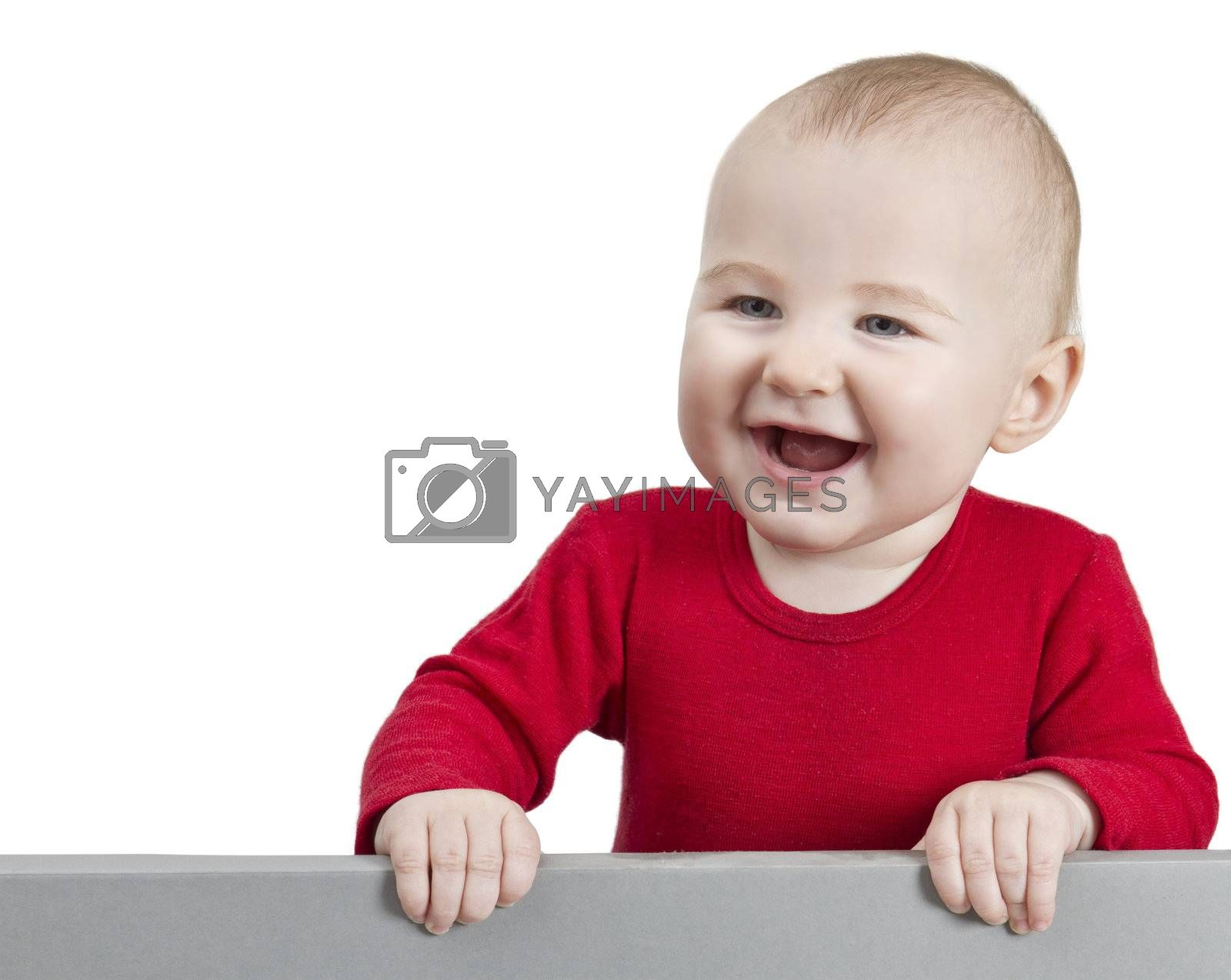 young child with red shirt holding shield. isolate on white background