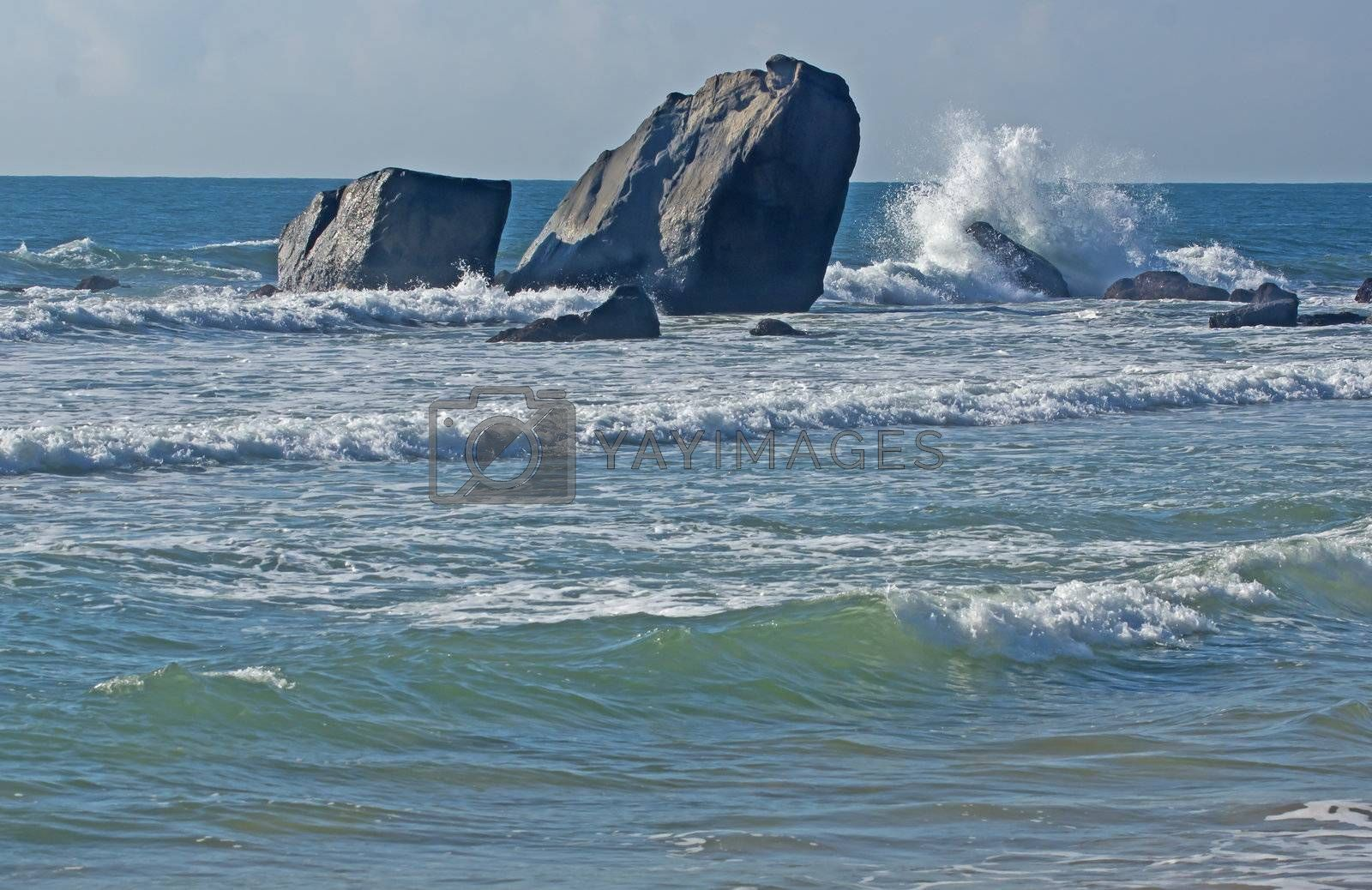 The sea and the sky, the white waves, black rocks, very beautiful