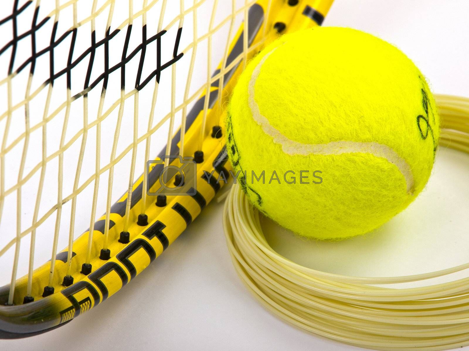 tennis racket string and yellow ball
