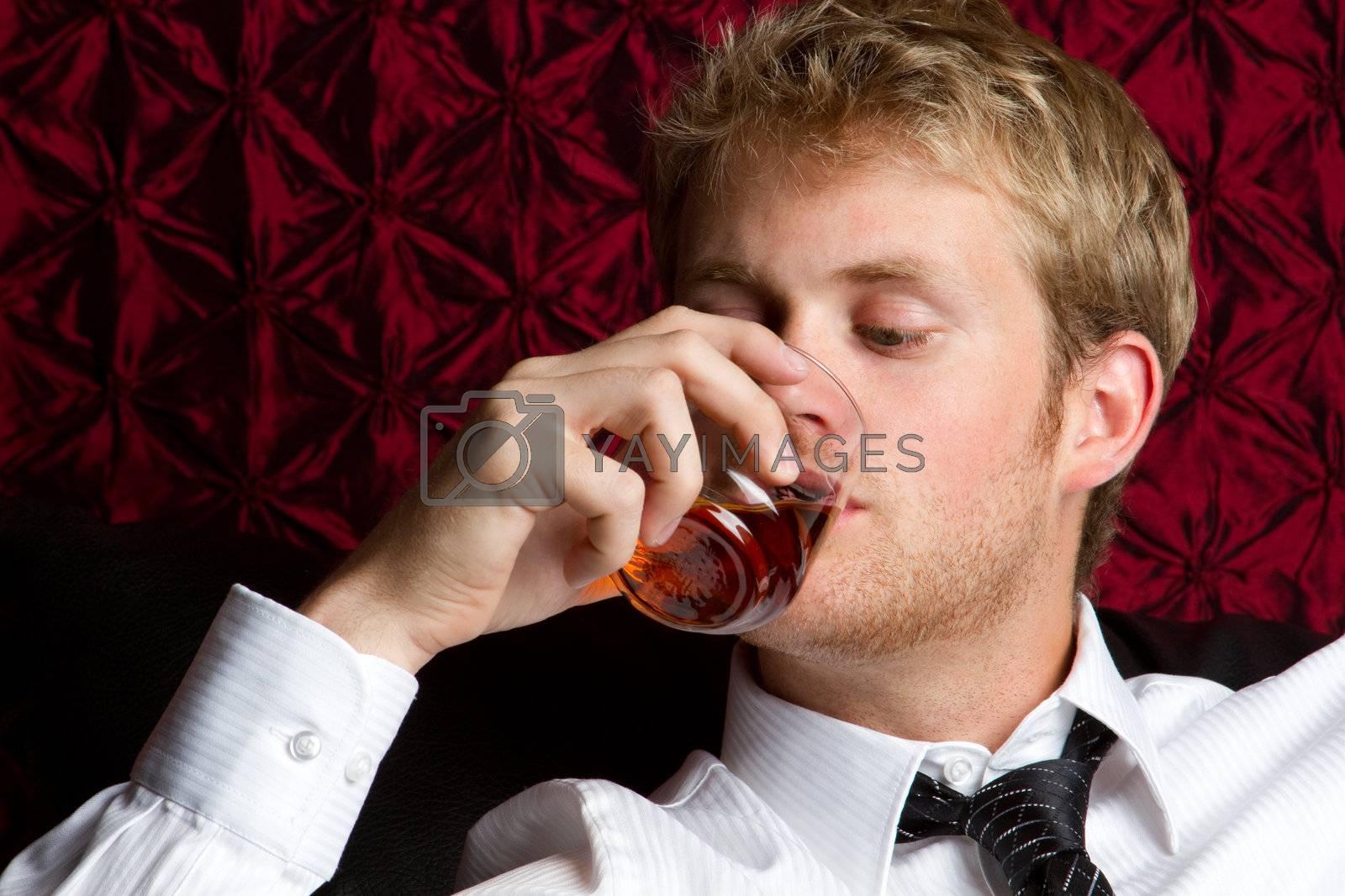 Business man drinking scotch alcohol