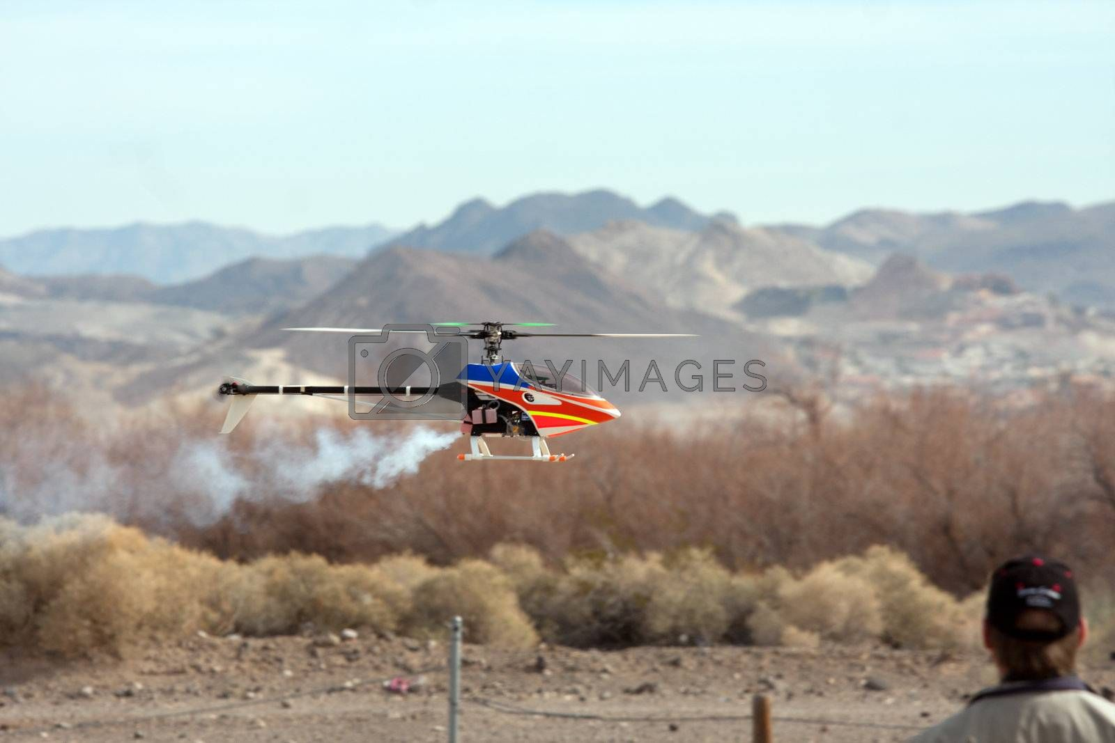RC helicopter in flight in front of mountains