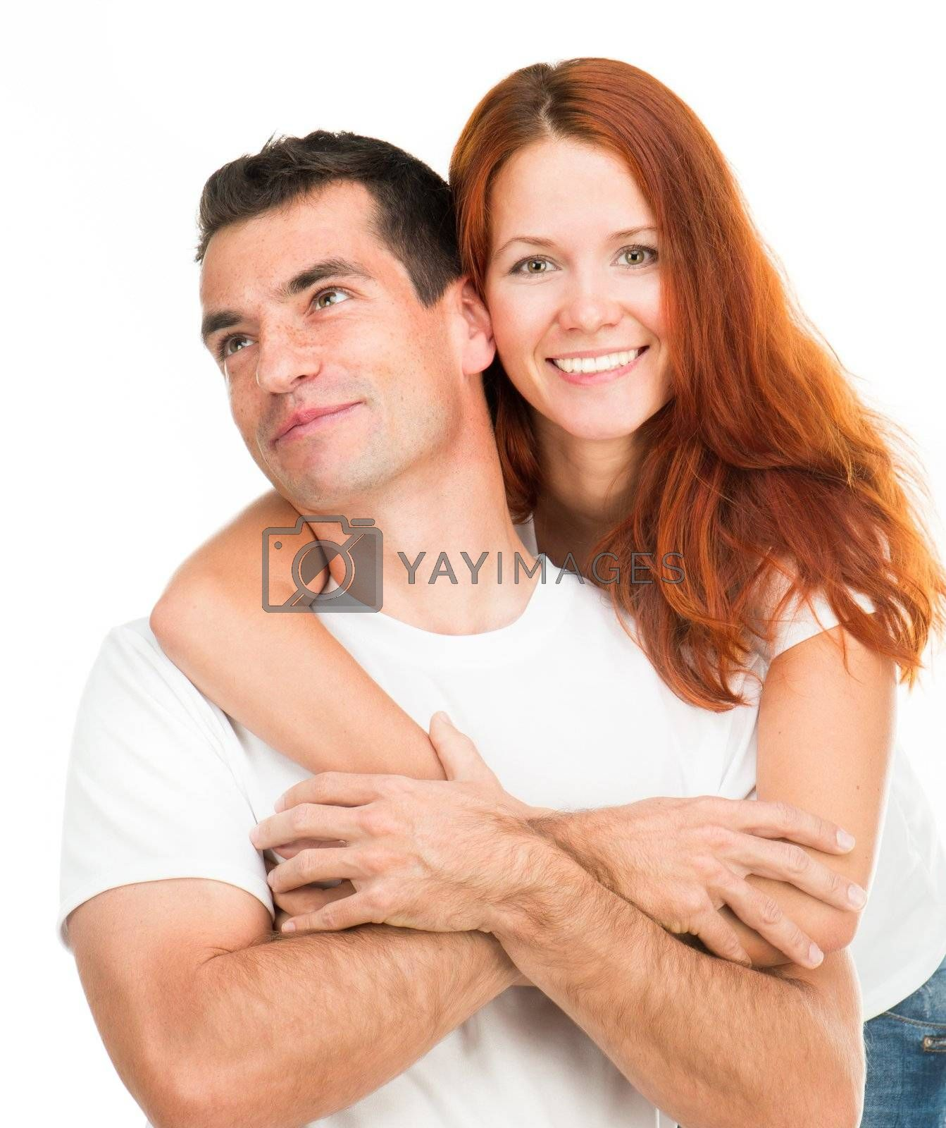 Young happy couple hugging on white background