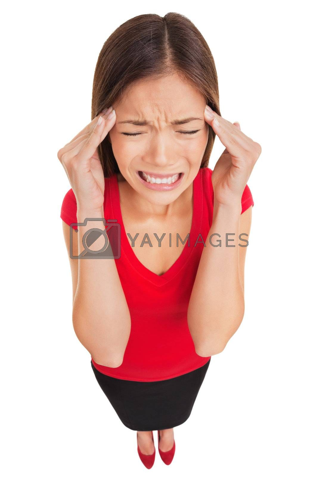 Woman suffering from a migraine headache rubbing her temples with her fingers and grimacing in pain, high angle full length studio portrait isolated on white background. Asian Caucasian female model.