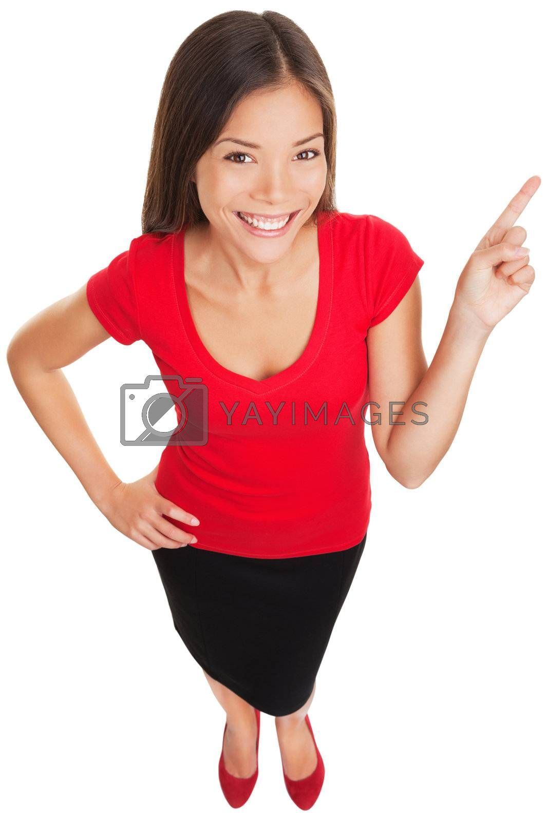 Pointing showing woman smiling cheerful. Funny high angle portrait of a beautiful happy woman pointing with her finger at copy space. Multiracial Asian Caucasian business woman isolated on white.