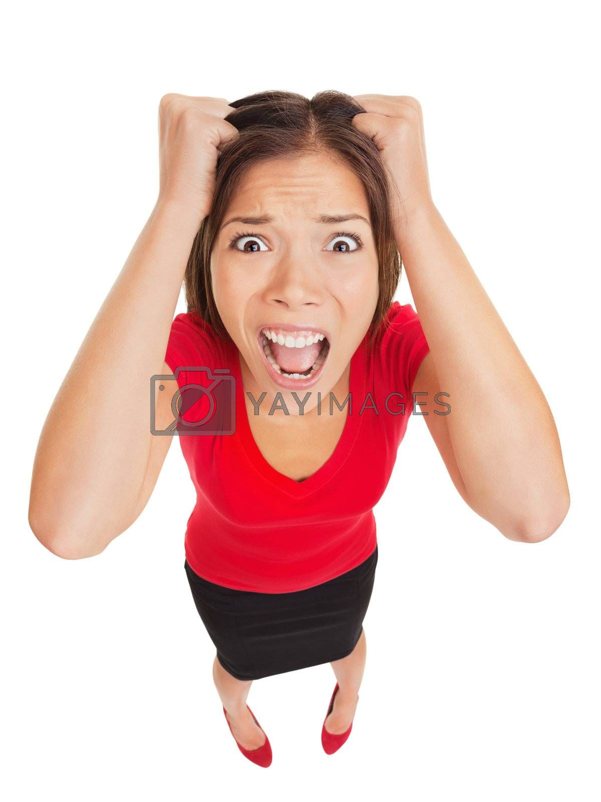 Appalled woman with a terrified expression looking up into the camera in a humorous full body high angle studio portrait isolated on white background in high angle view. Funny multicultural Asian.