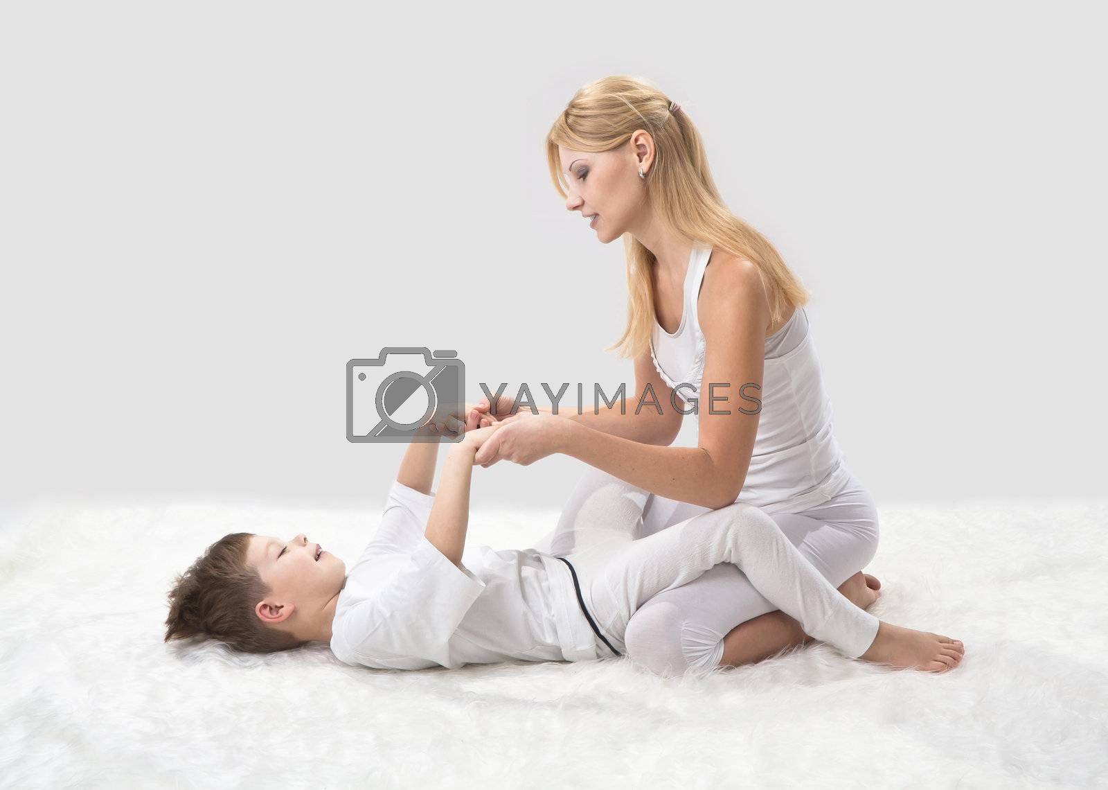 Mother and son do yoga before bed
