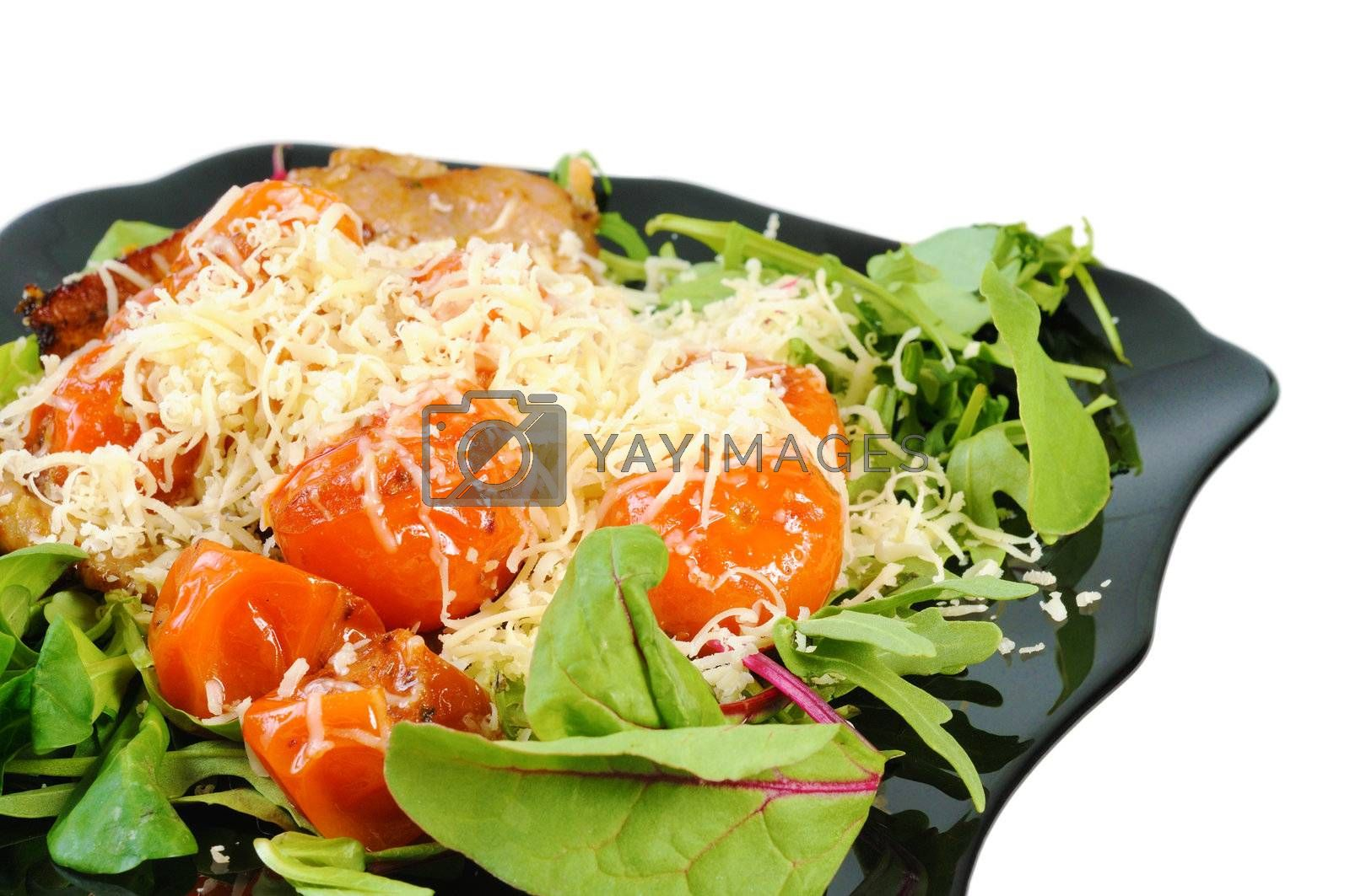 Salad with arugula and tomatoes. Isolated on white.